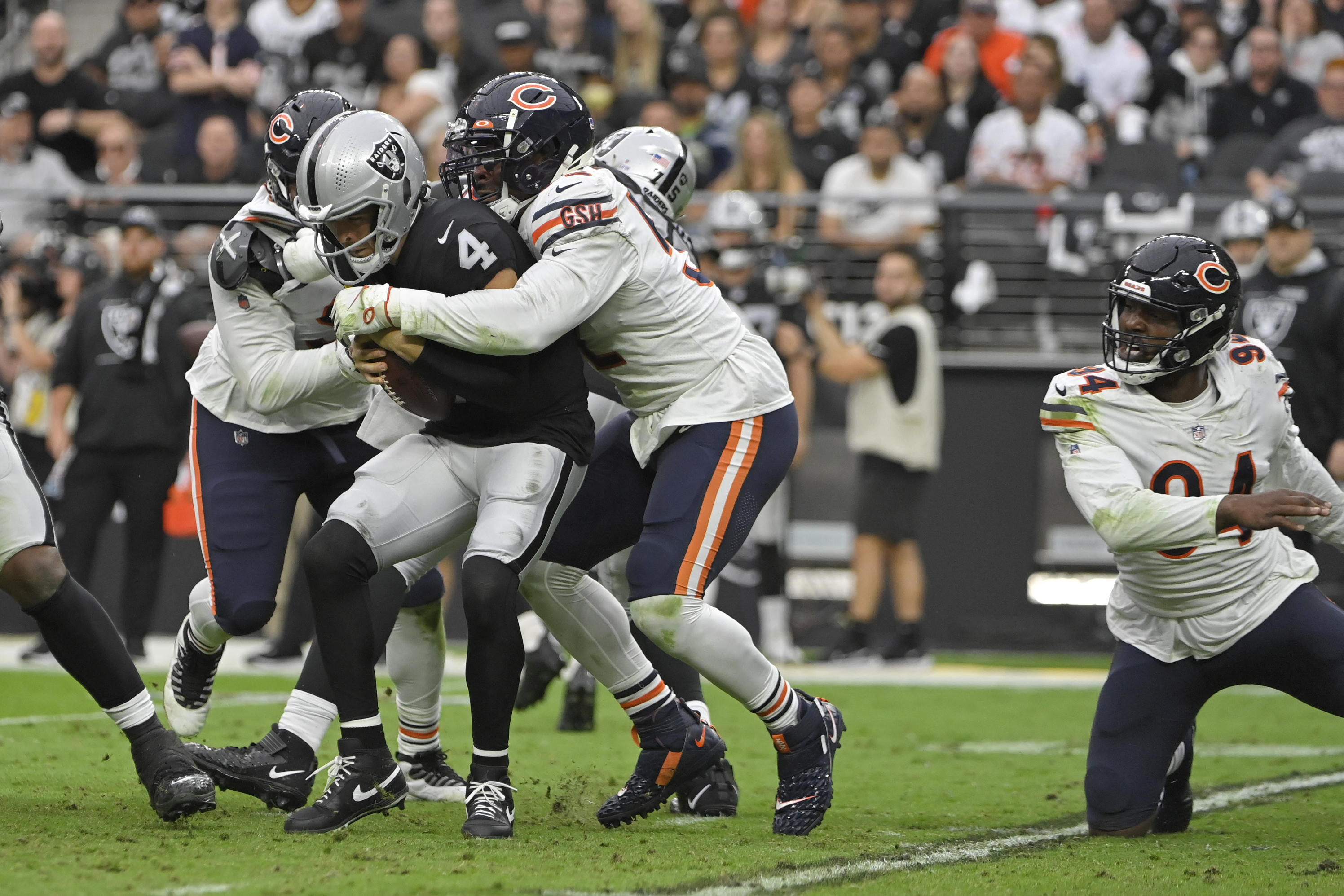 Outside linebacker Khalil Mack (52, sacking Derek Carr last week) has five of the Bears' NFL-leading 18 sacks through five games this season —not including a sack on a two-point conversion against the Raiders.