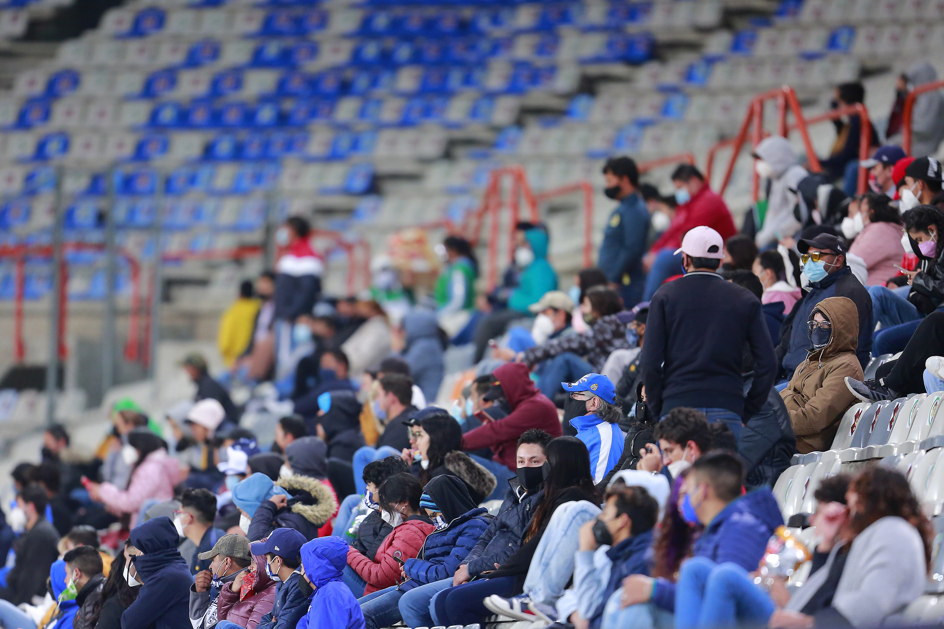 Fans wearing a protective mask prior to the 12th round match between Pachuca and Tigres UANL as part of the Torneo Guard1anes 2021 Liga MX at Hidalgo Stadium on March 18, 2021 in Pachuca, Mexico.