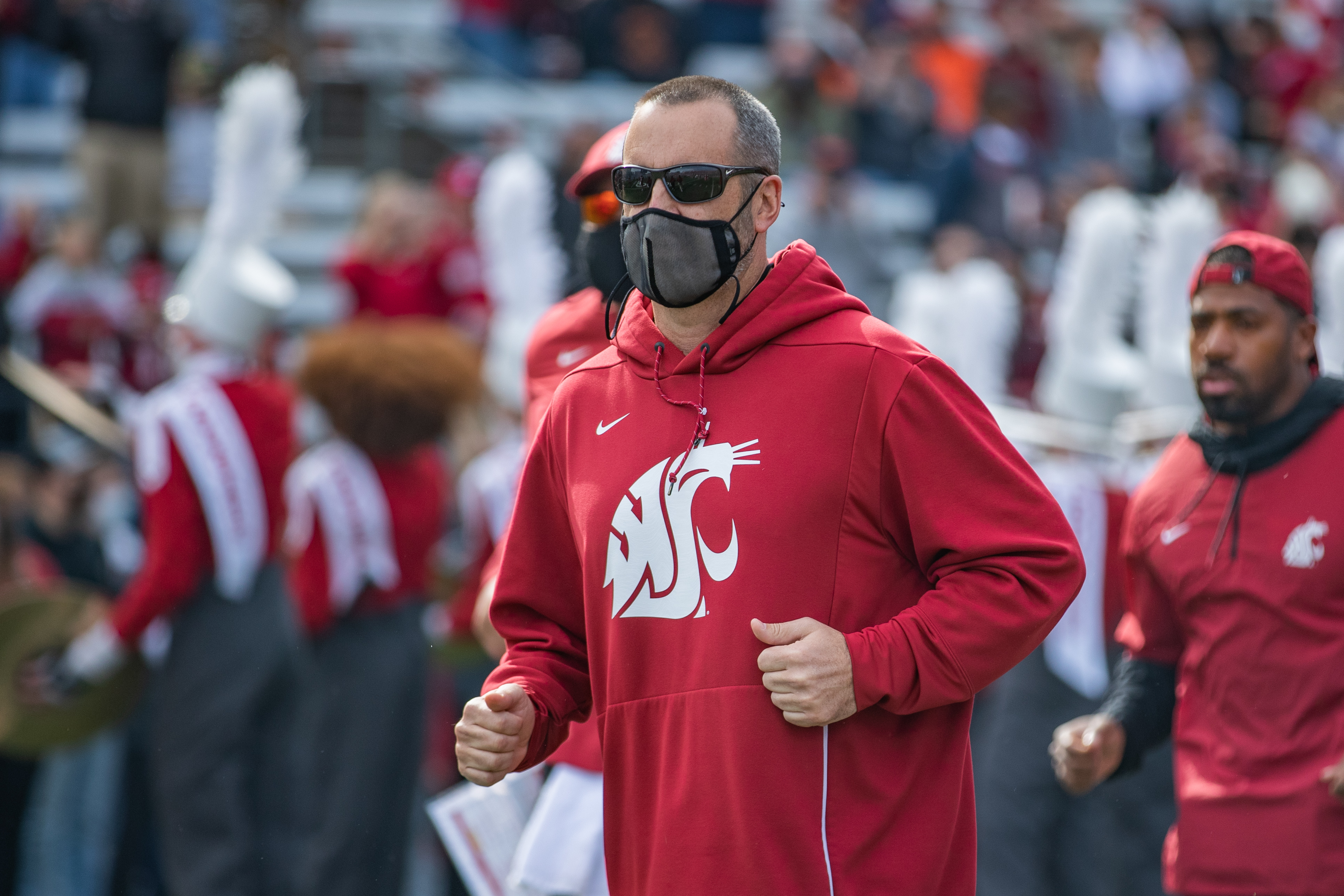 PULLMAN, WA - OCTOBER 9: Washington State head coach Nick Rolovich runs out of the tunnel prior to a PAC 12 conference matchup between the Oregon State Beavers and the Washington State Cougars on October 9, 2021, at Martin Stadium in Pullman, WA.