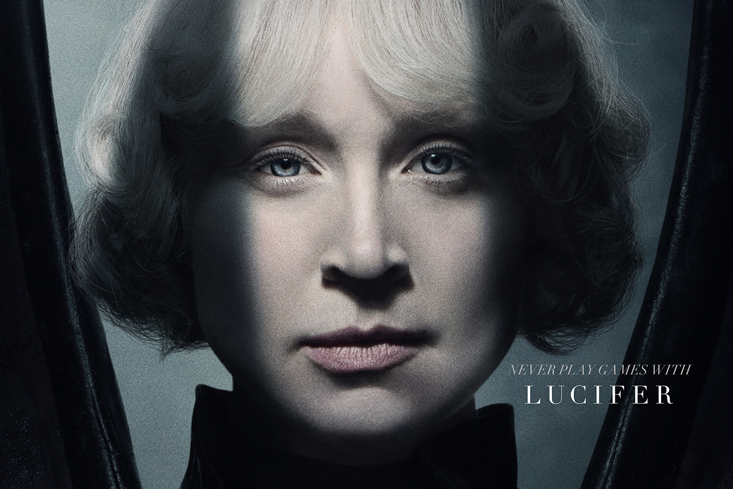 Gwendoline Christie as Lucifer — her white hair bobbed and waved like a biblical angel, her face framed by the shadow of black wings — in a promo image for Sandman on HBO Max.