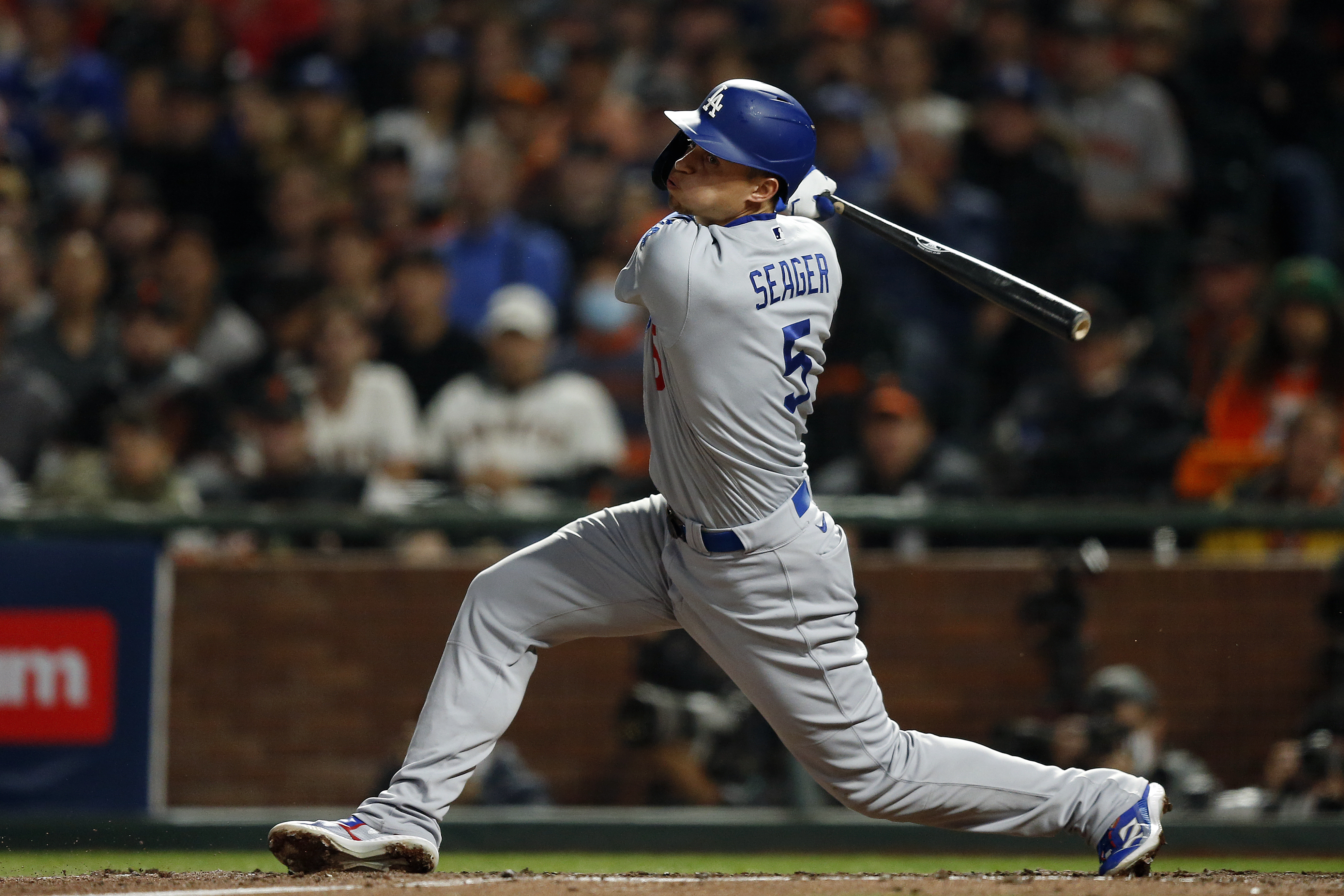 Corey Seager #5 of the Los Angeles Dodgers hits an RBI double in the sixth inning during Game 5 of the NLDS between the Los Angeles Dodgers and the San Francisco Giants at Oracle Park on Thursday, October 14, 2021 in San Francisco, California.