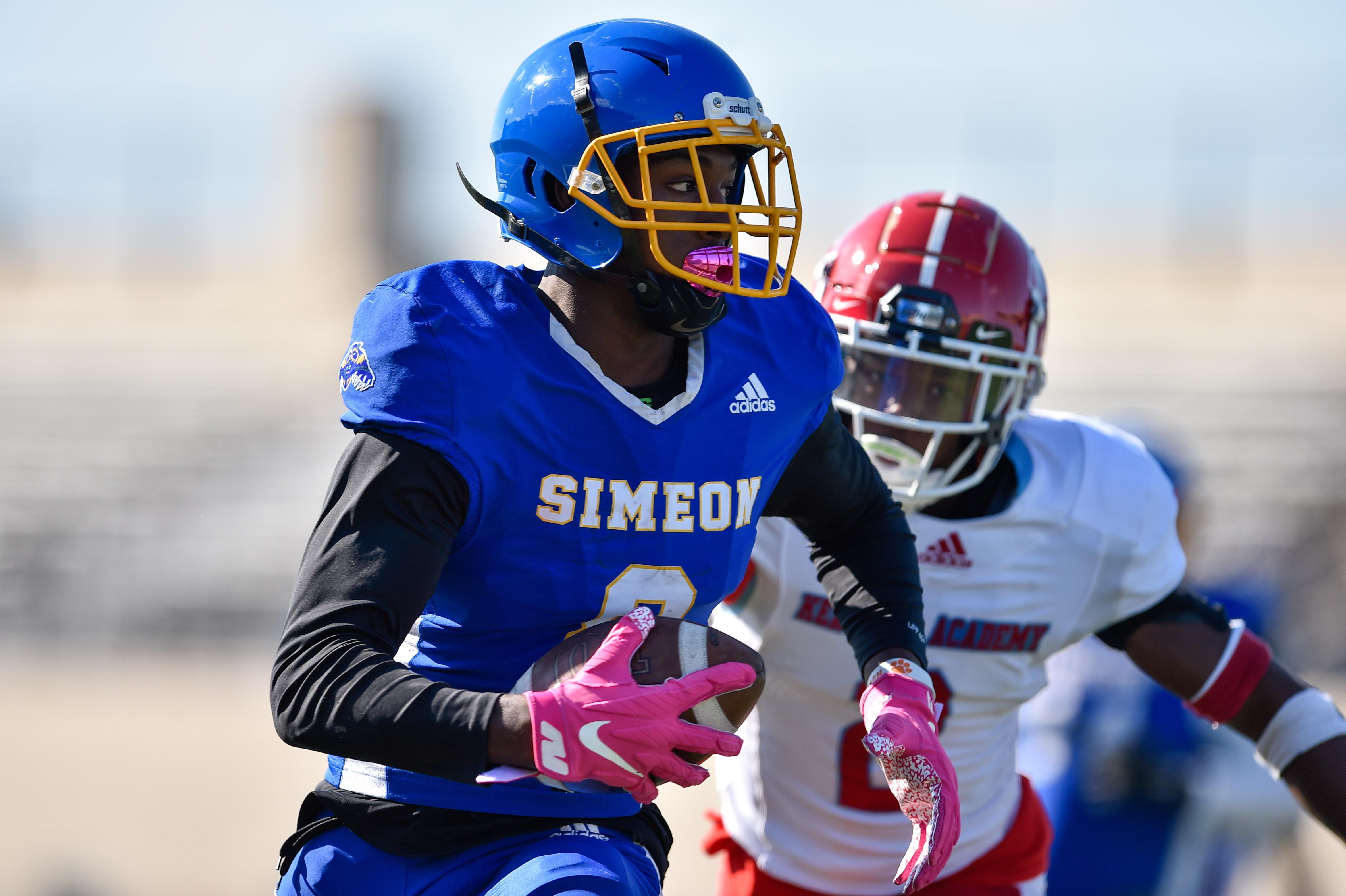 Simeon's Malik Elzy (8) runs the ball against Kenwood.