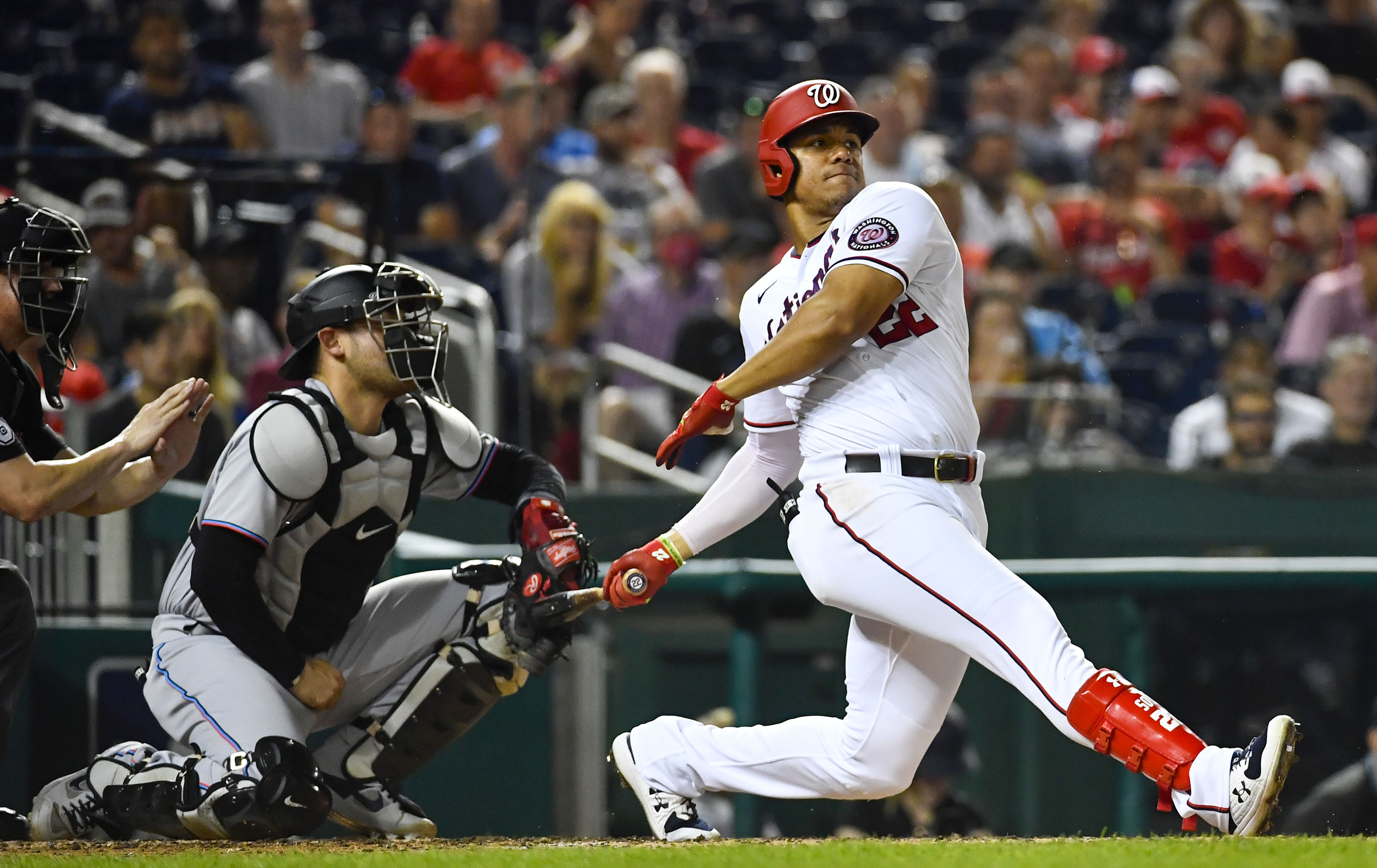 Washington Nationals right fielder Juan Soto (22) hits an RBI single against the Miami Marlins during the third inning at Nationals Park