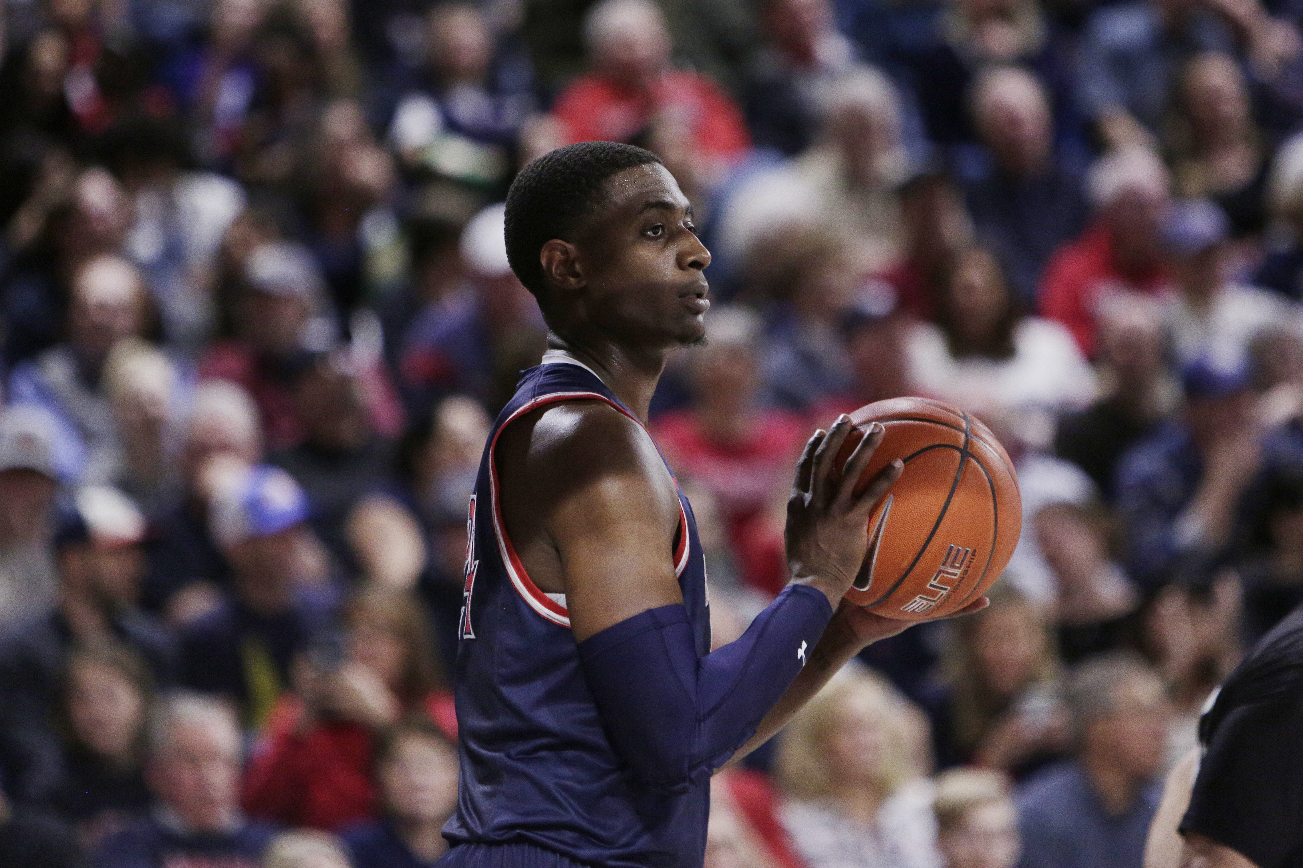 Saint Mary's forward Malik Fitts prepares to inbound the ball