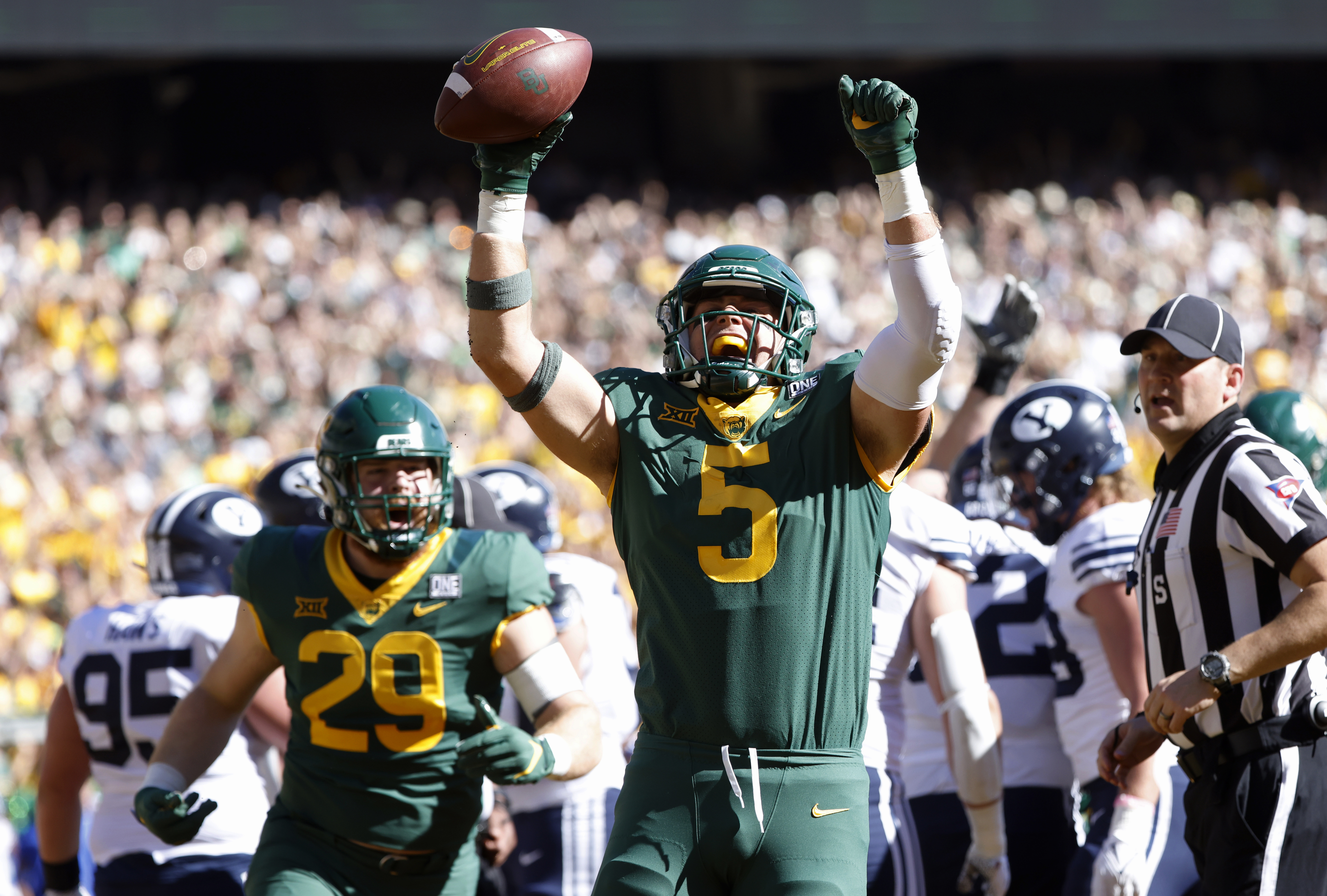 Baylor's Dillon Doyle (5) celebrates with teammate Jackson Shupp (29) after scoring a touchdown against BYU.