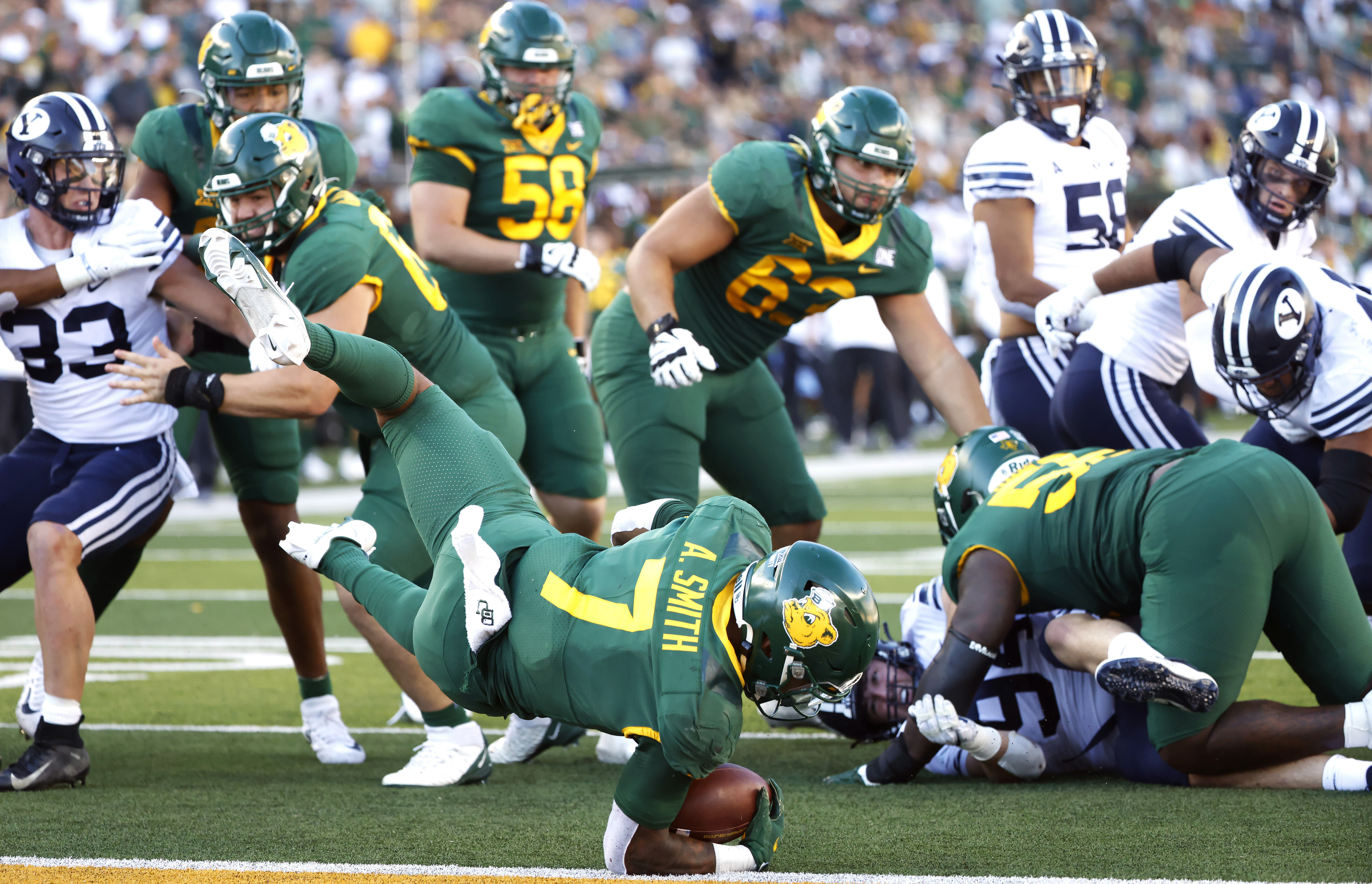 Baylor running back Abram Smith (7) dives for a touchdown against BYU