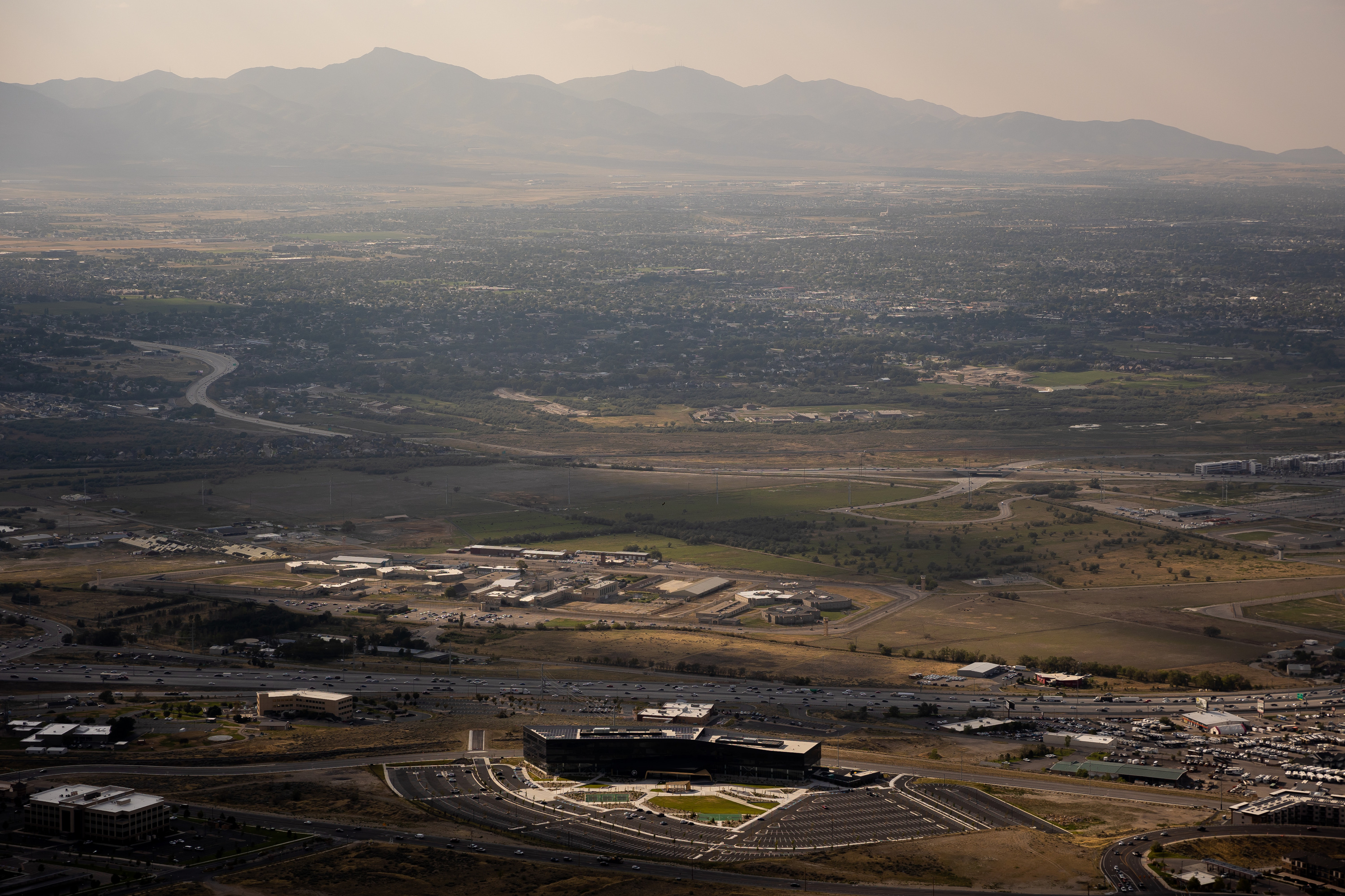 The Utah State Prison, the headquarters of tech company Pluralsight and I-15 in Draper are pictured on Wednesday, Aug. 25, 2021.