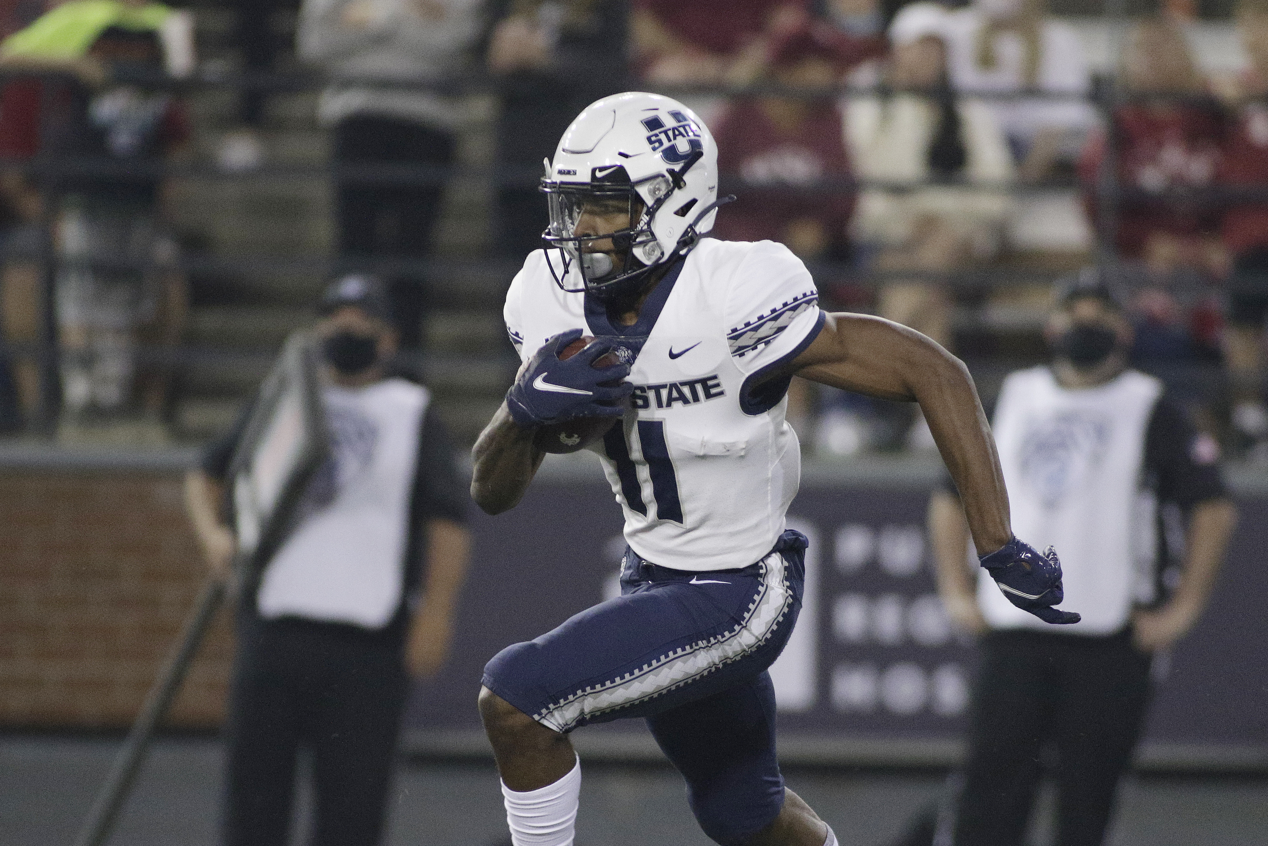 Utah State wide receiver Savon Scarver carries the ball
