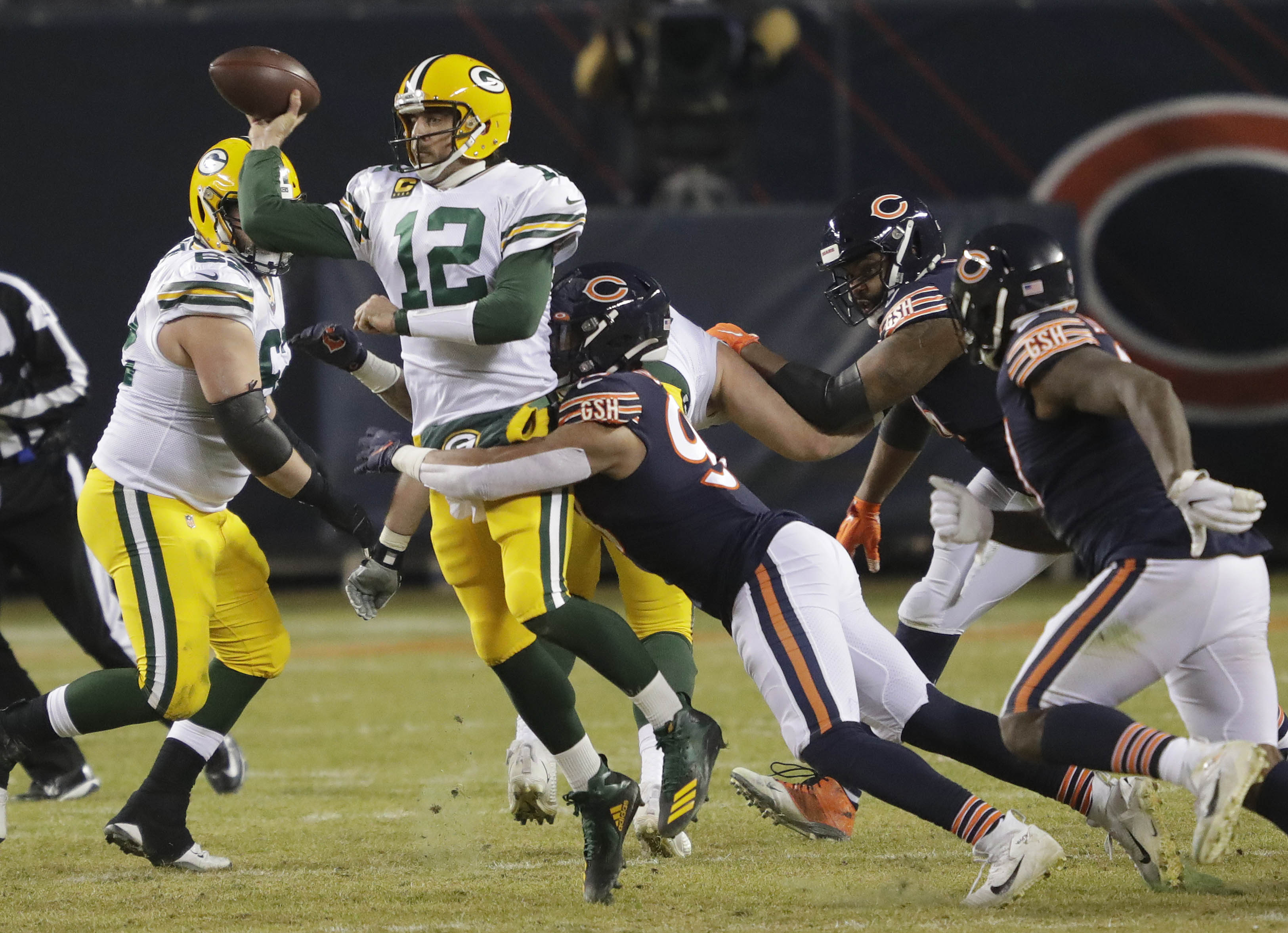 Green Bay Packers quarterback Aaron Rodgers (12) passes the ball under pressure from Chicago Bears linebacker Trevis Gipson (99) during their football game Sunday, January 3, 2021, at Soldier Field in Chicago, Ill.