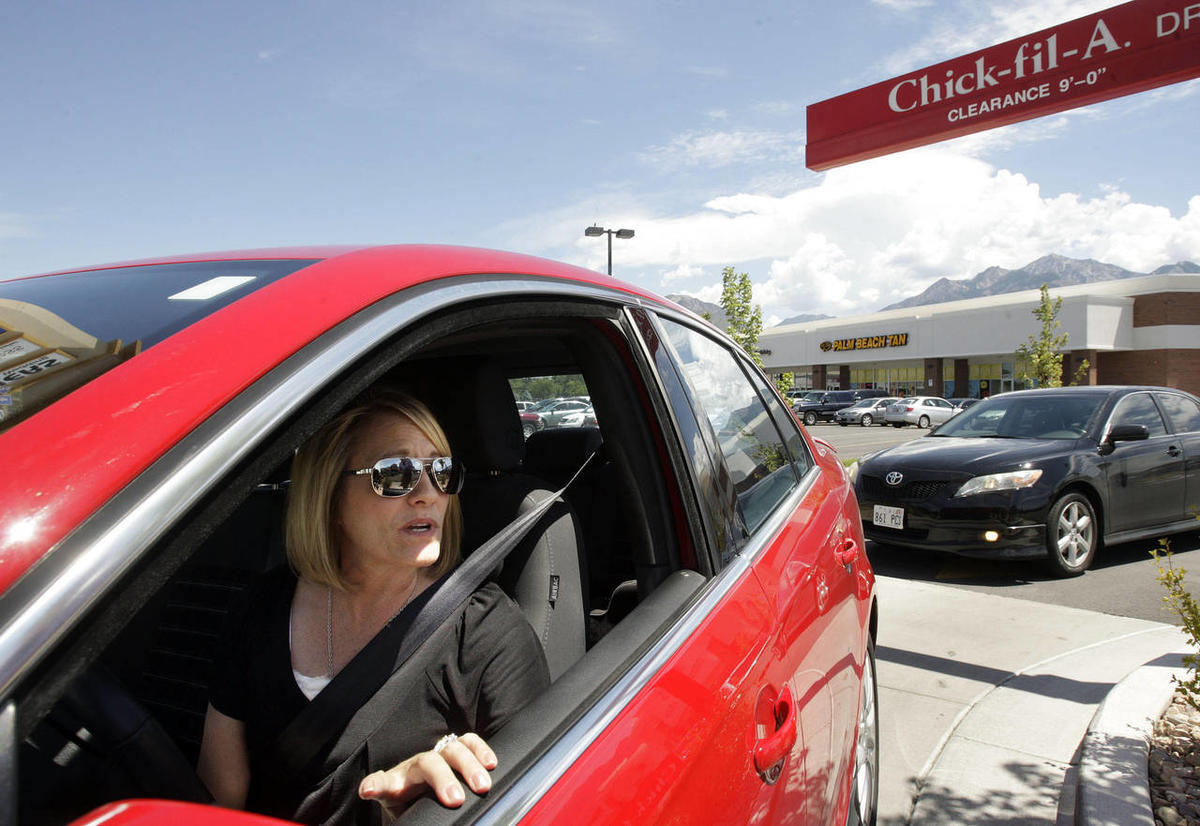 A Chick-fil-A customer gets ready to order lunch.