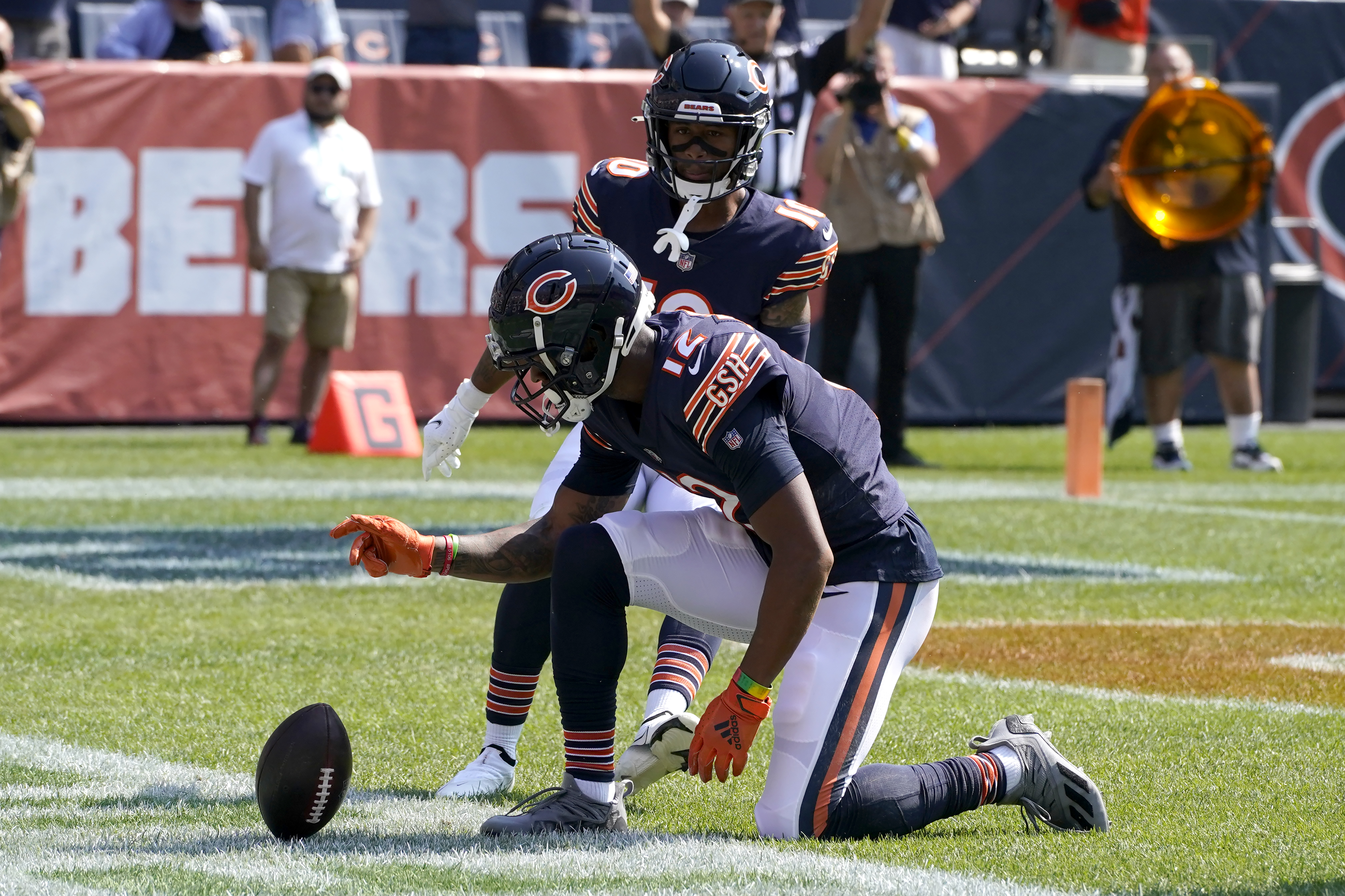 Chicago Bears' Allen Robinson (12) celebrates his touchdown against the Cincinnati Bengals Sunday, Sept. 19, 2021, in Chicago. (AP Photo/Nam Y. Huh) ORG XMIT: CXB114