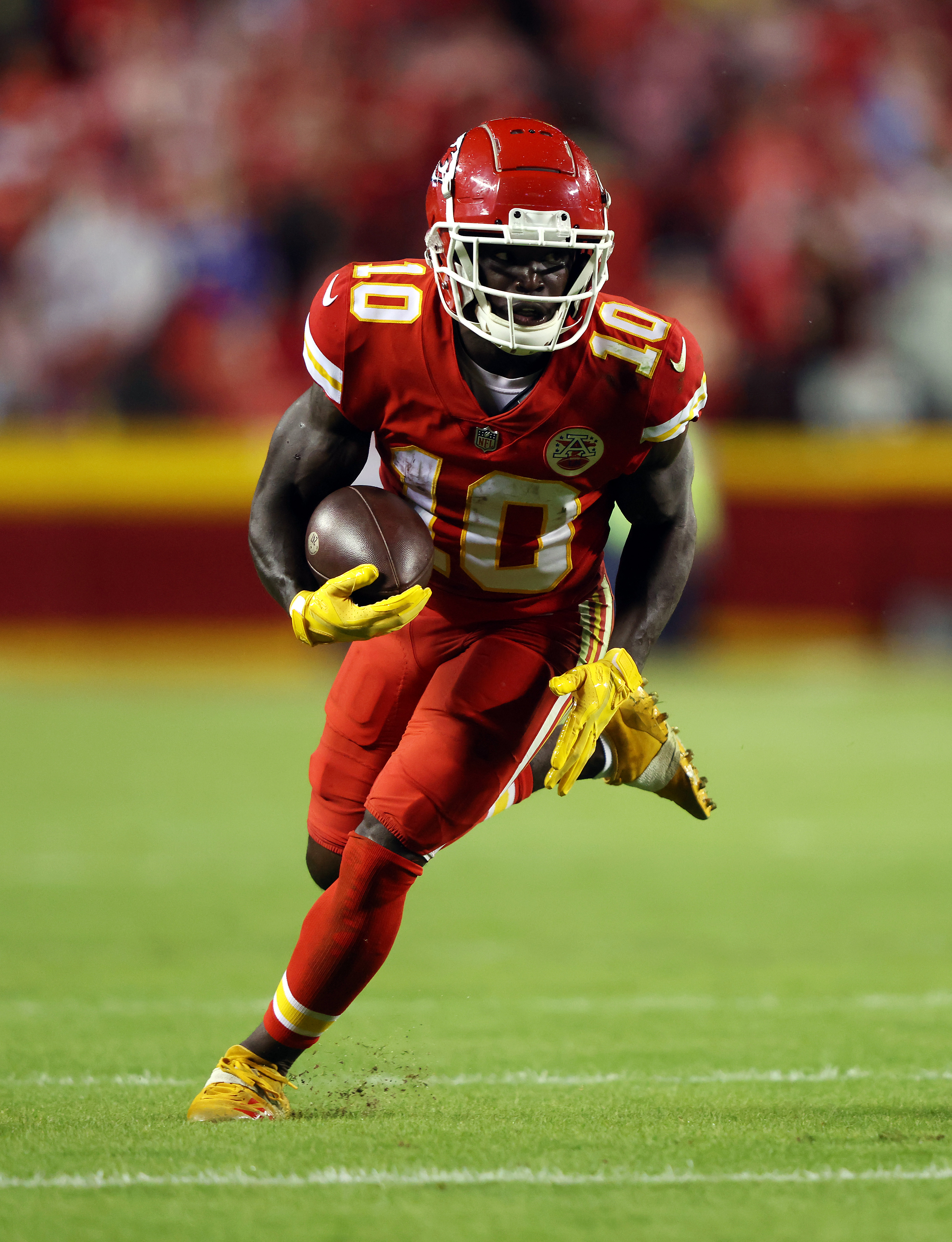 Wide-receiver Tyreek Hill #10 of the Kansas City Chiefs carries the ball during the game against the Buffalo Bills at Arrowhead Stadium on October 10, 2021 in Kansas City, Missouri.