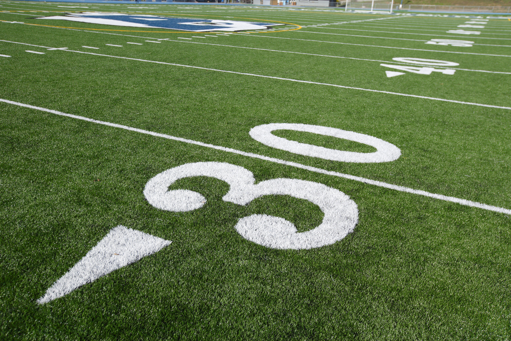 A photo of the 30-yard line on a football field