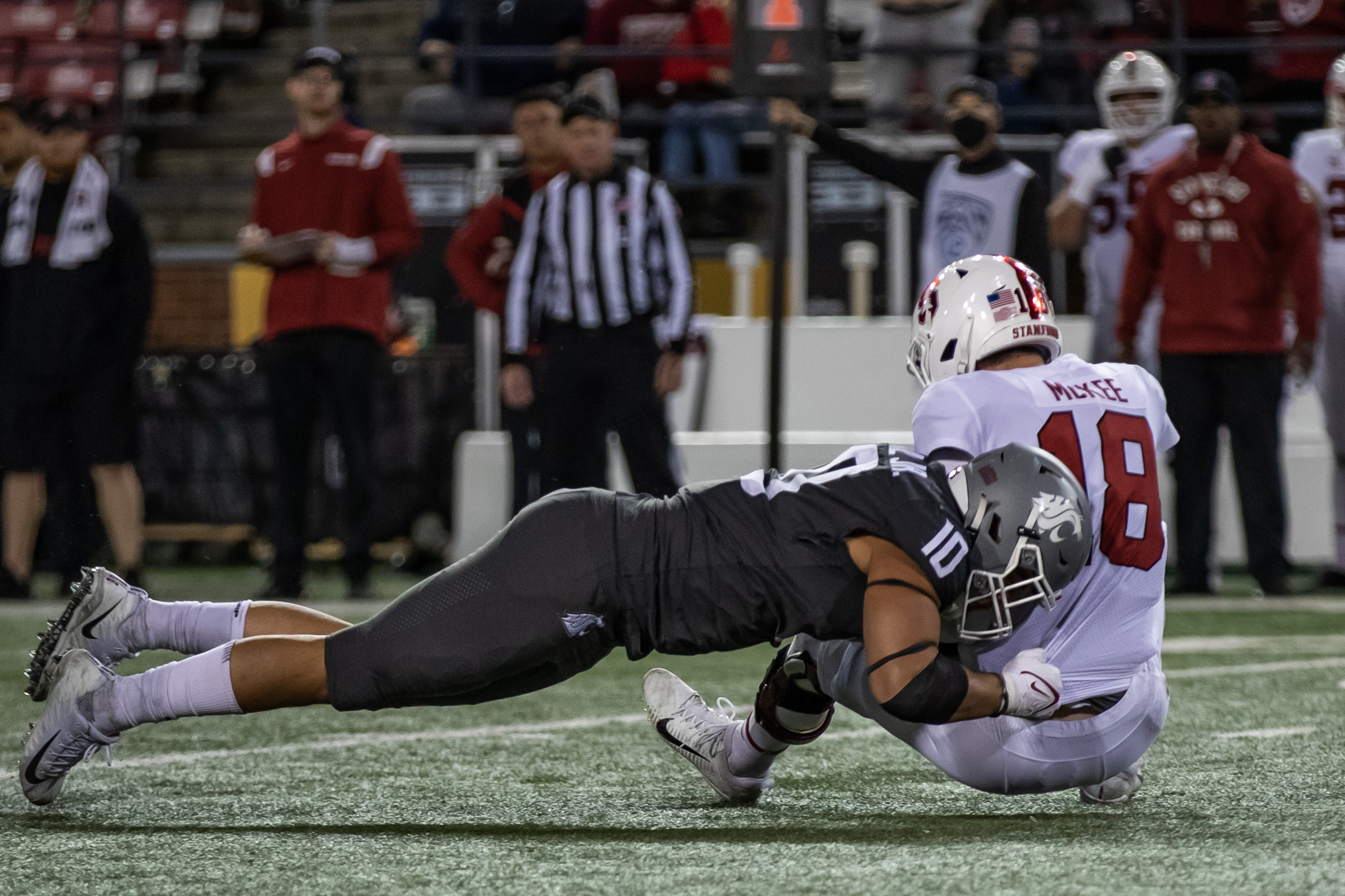 PULLMAN, WA - OCTOBER 16: Washington State EDGE Ron Stone Jr. (10) takes down the quarterback during the second half of a PAC 12 conference matchup between the Stanford Cardinal and the Washington State Cougars on October 16, 2021, at Martin Stadium in Pullman, WA.