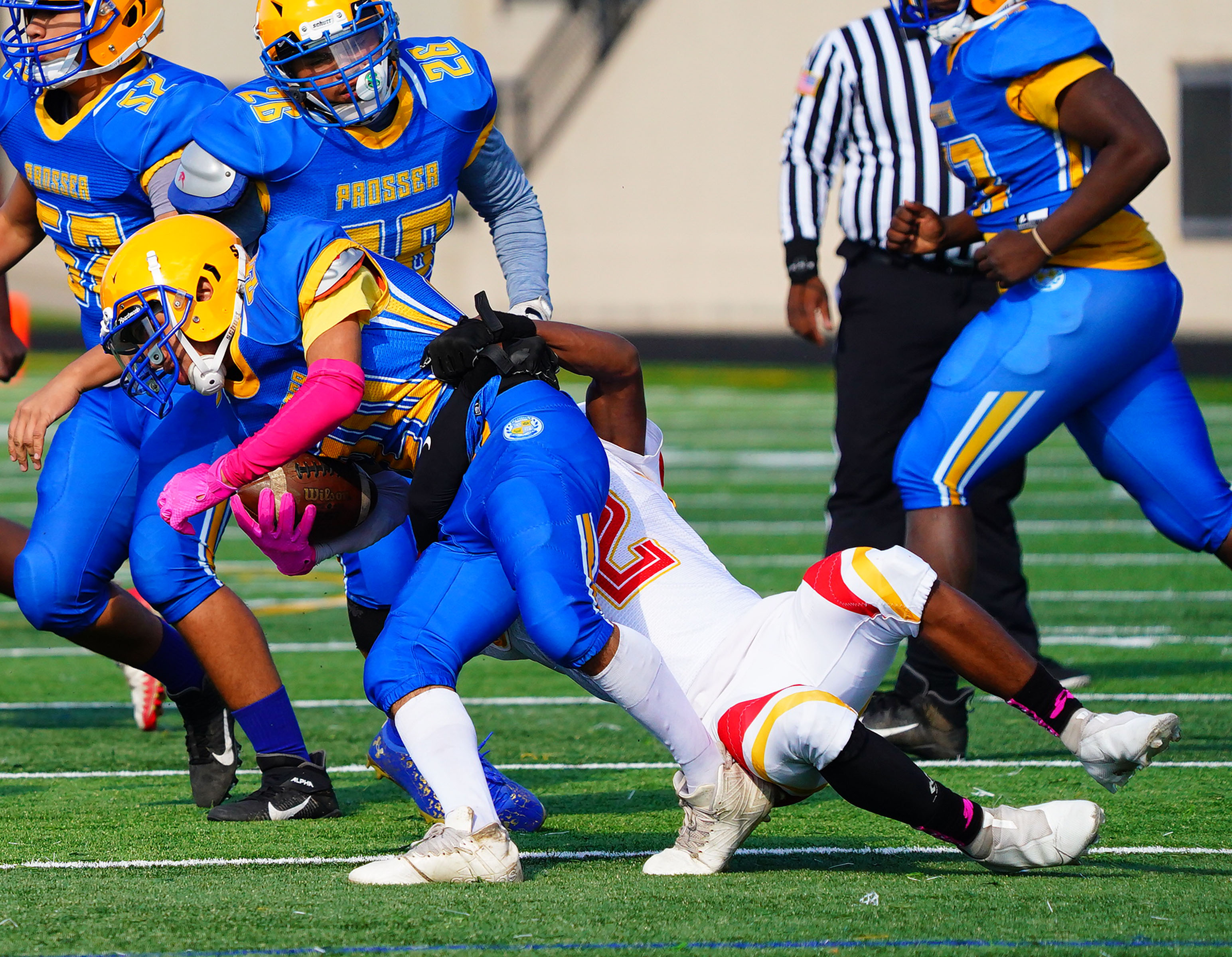 North Lawndale's Cortez Roach (2) tackles Prosser's Tyler Valladares (20) for a loss.