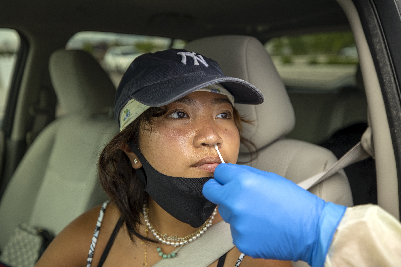 Kaitlyn Le receives a rapid COVID-19 antigen test.