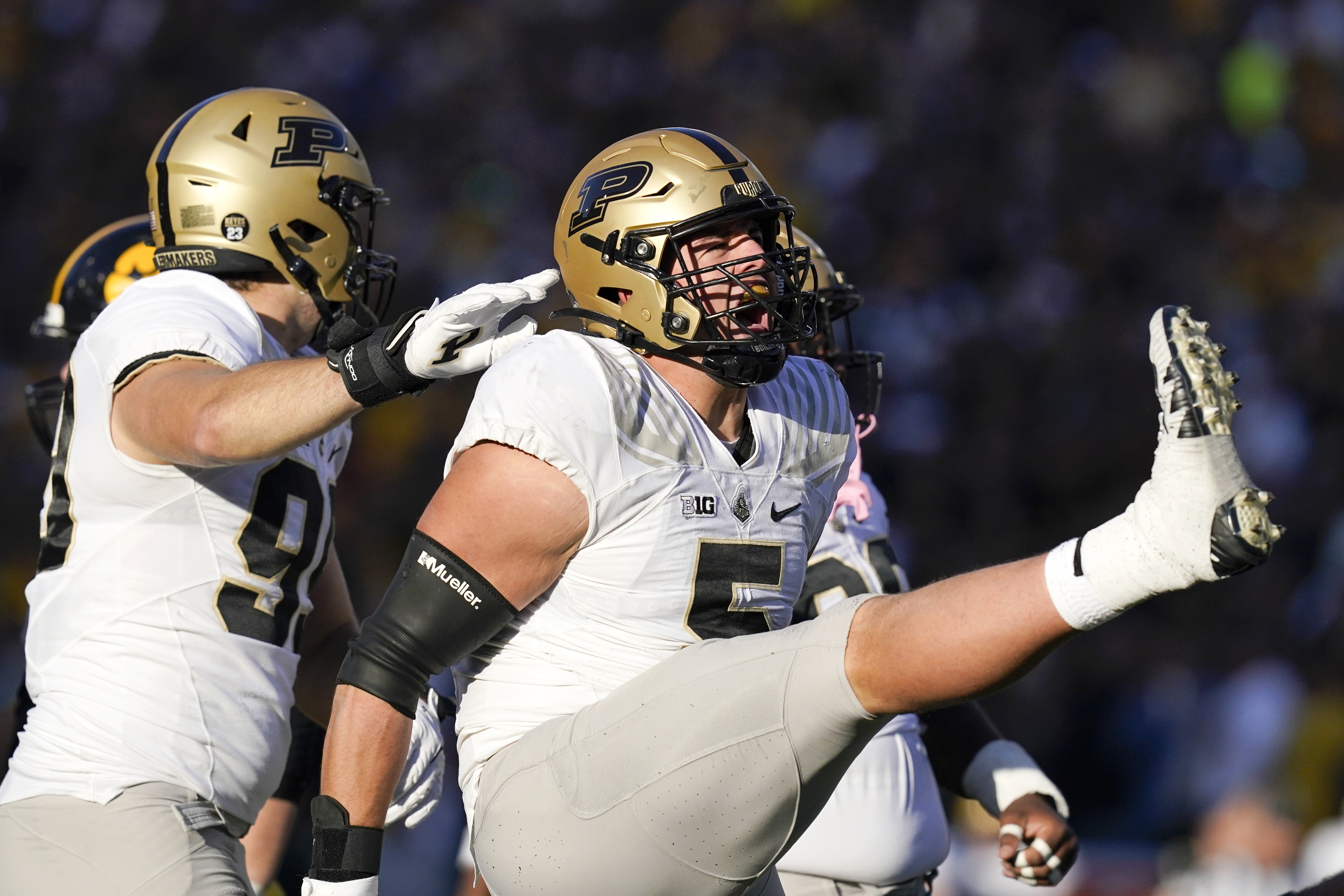 Purdue defensive end George Karlaftis (5) celebrates after a sack during the second half of Saturday's win over Iowa.