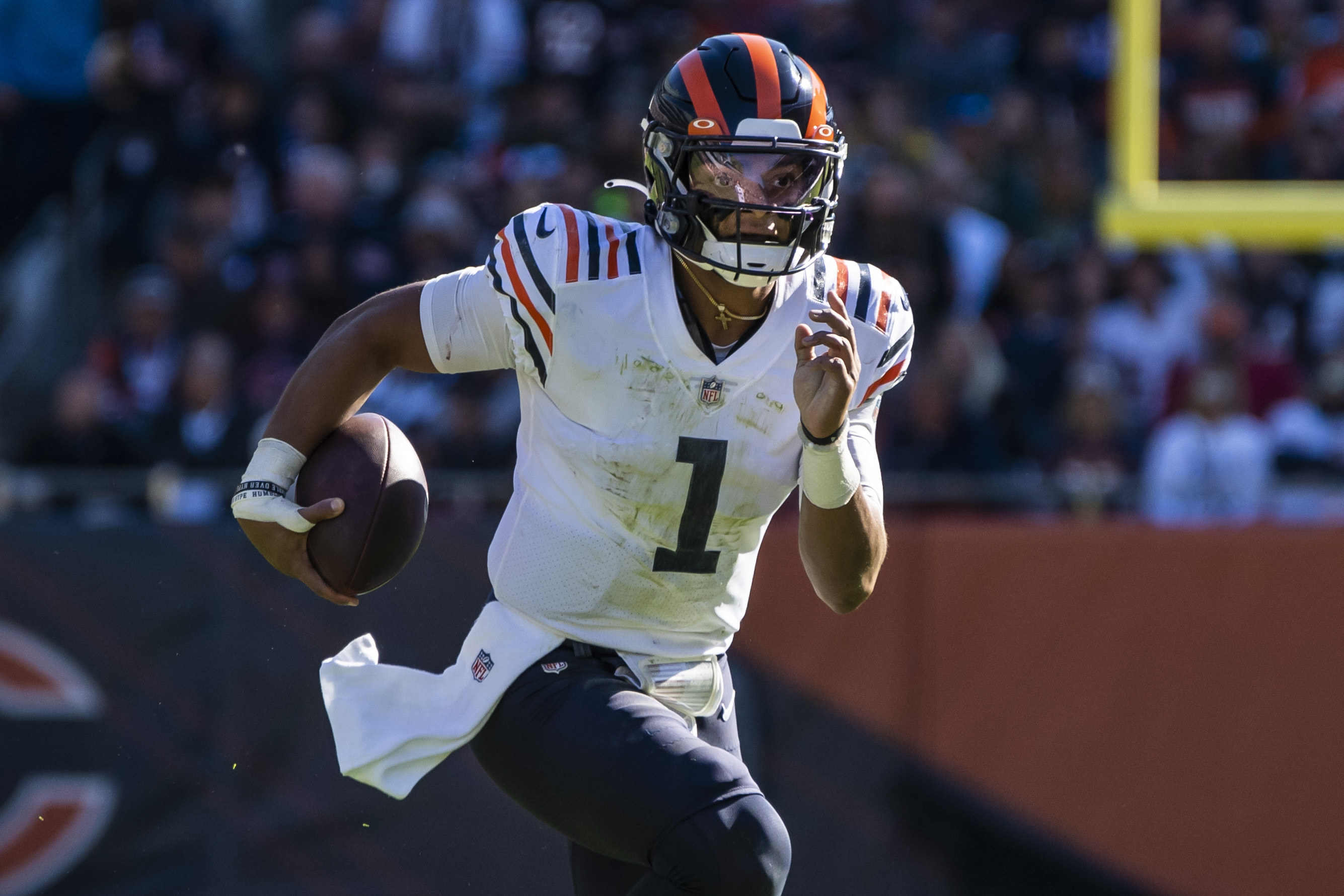 Bears quarterback Justin Fields runs against the Packers on Sunday.