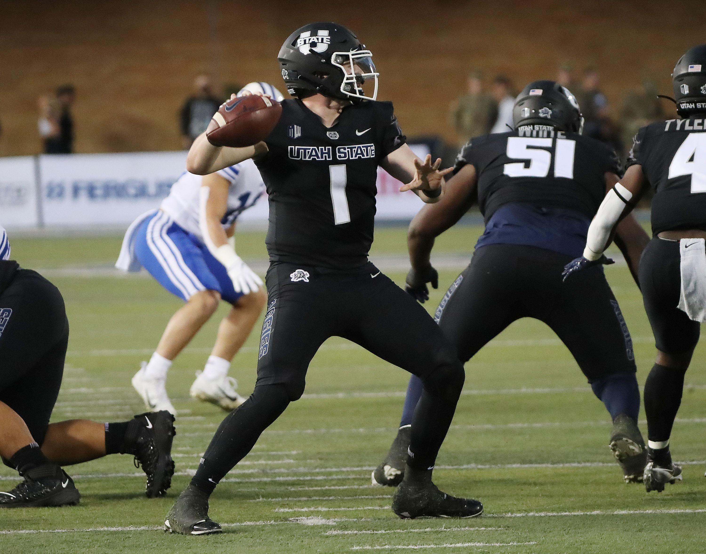 Utah State Aggies quarterback Logan Bonner (1) throws in Logan on Friday, Oct. 1, 2021.