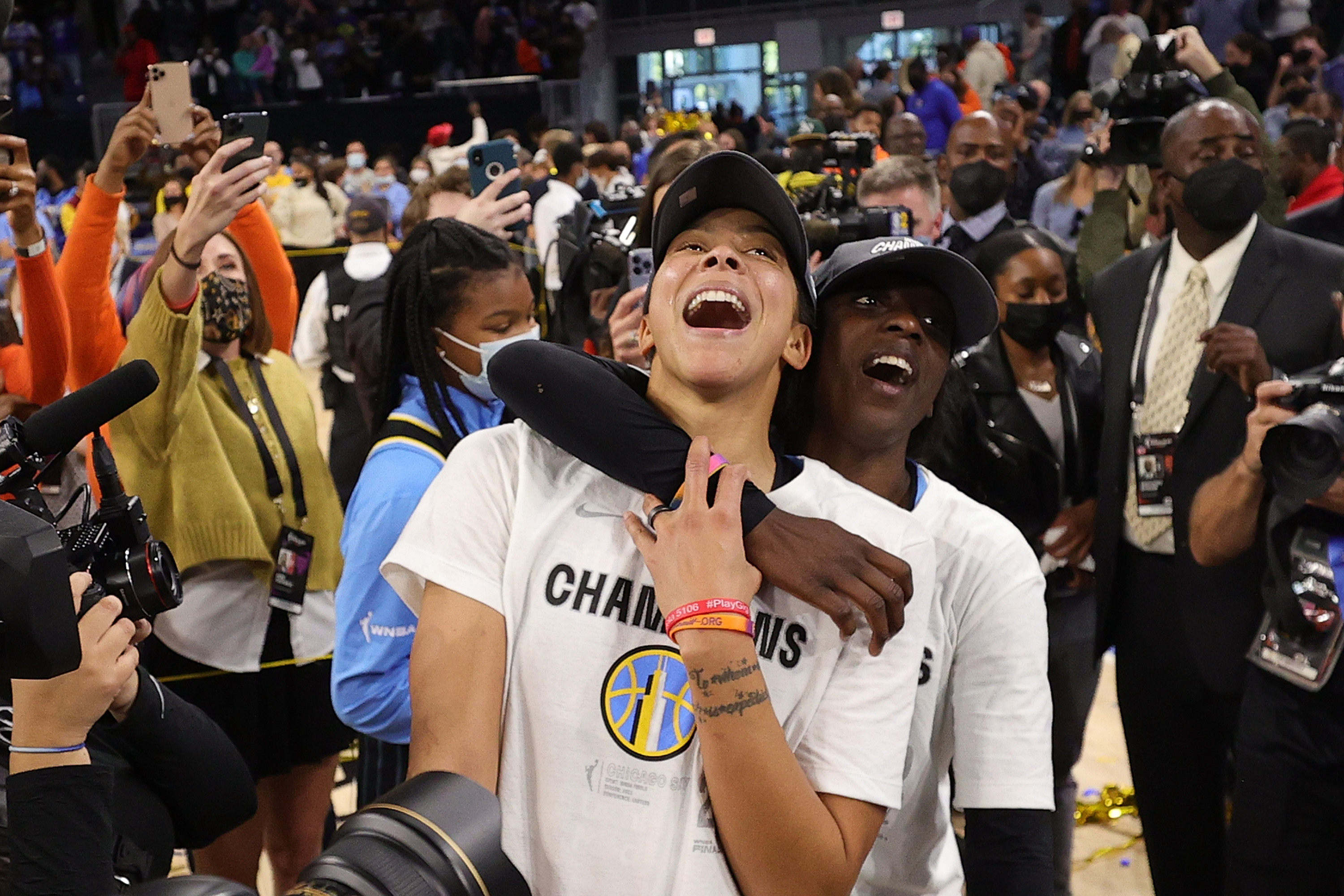The Sky's Candace Parker and Kahleah Copper celebrate after winning the WNBA championship at Wintrust Arena.