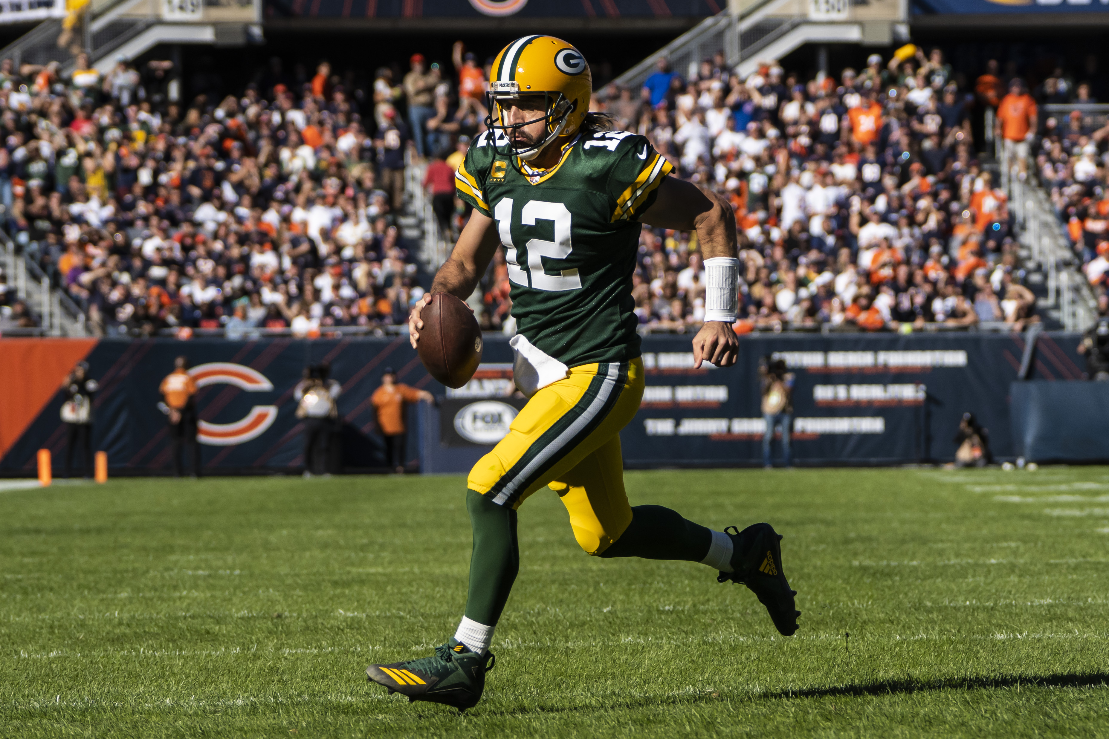 Packers quarterback Aaron Rodgers rushes for a touchdown during the fourth quarter of Sunday.