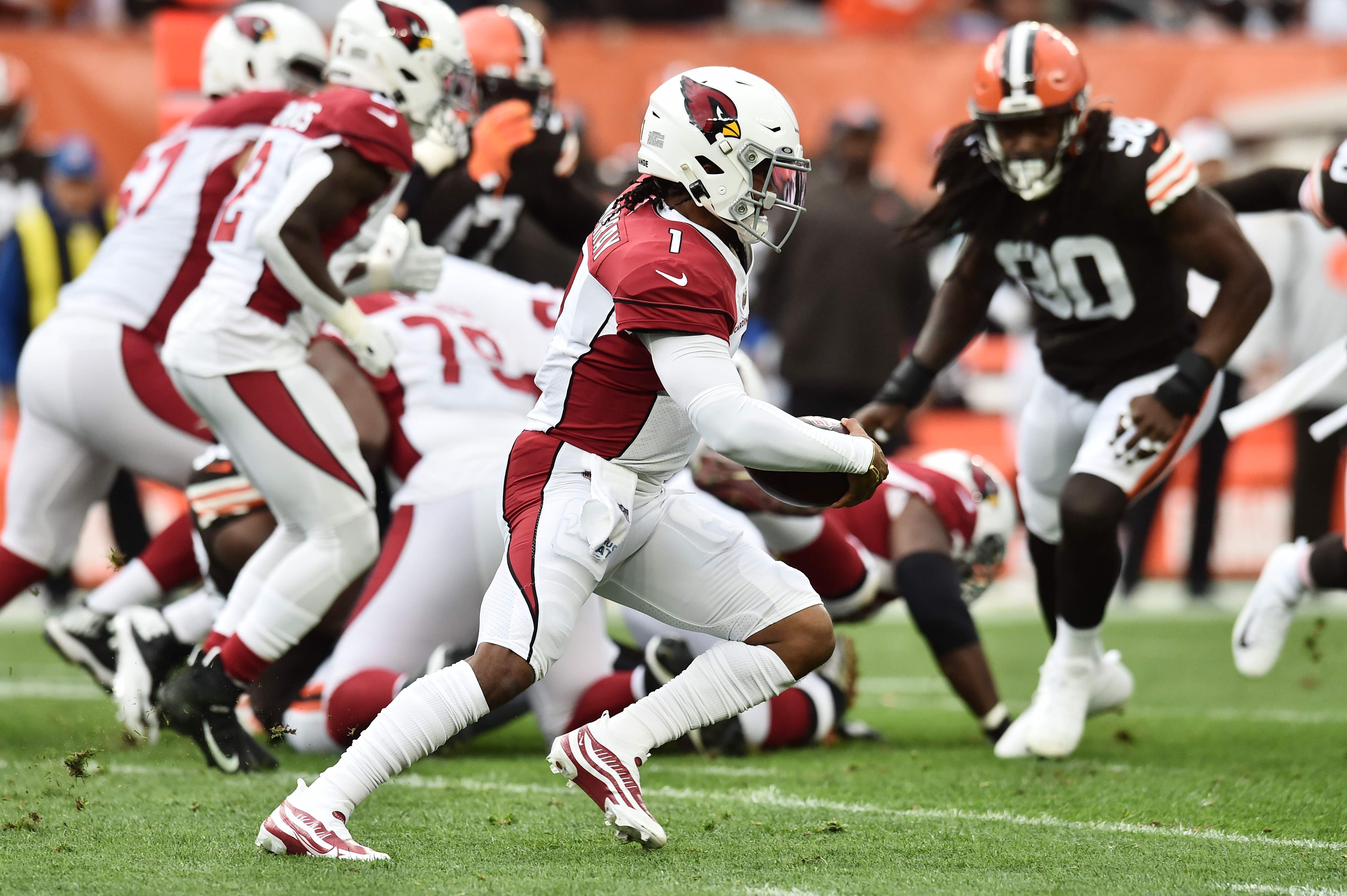 Arizona Cardinals quarterback Kyler Murray (1) runs with the ball during the first half against the Cleveland Browns at FirstEnergy Stadium.