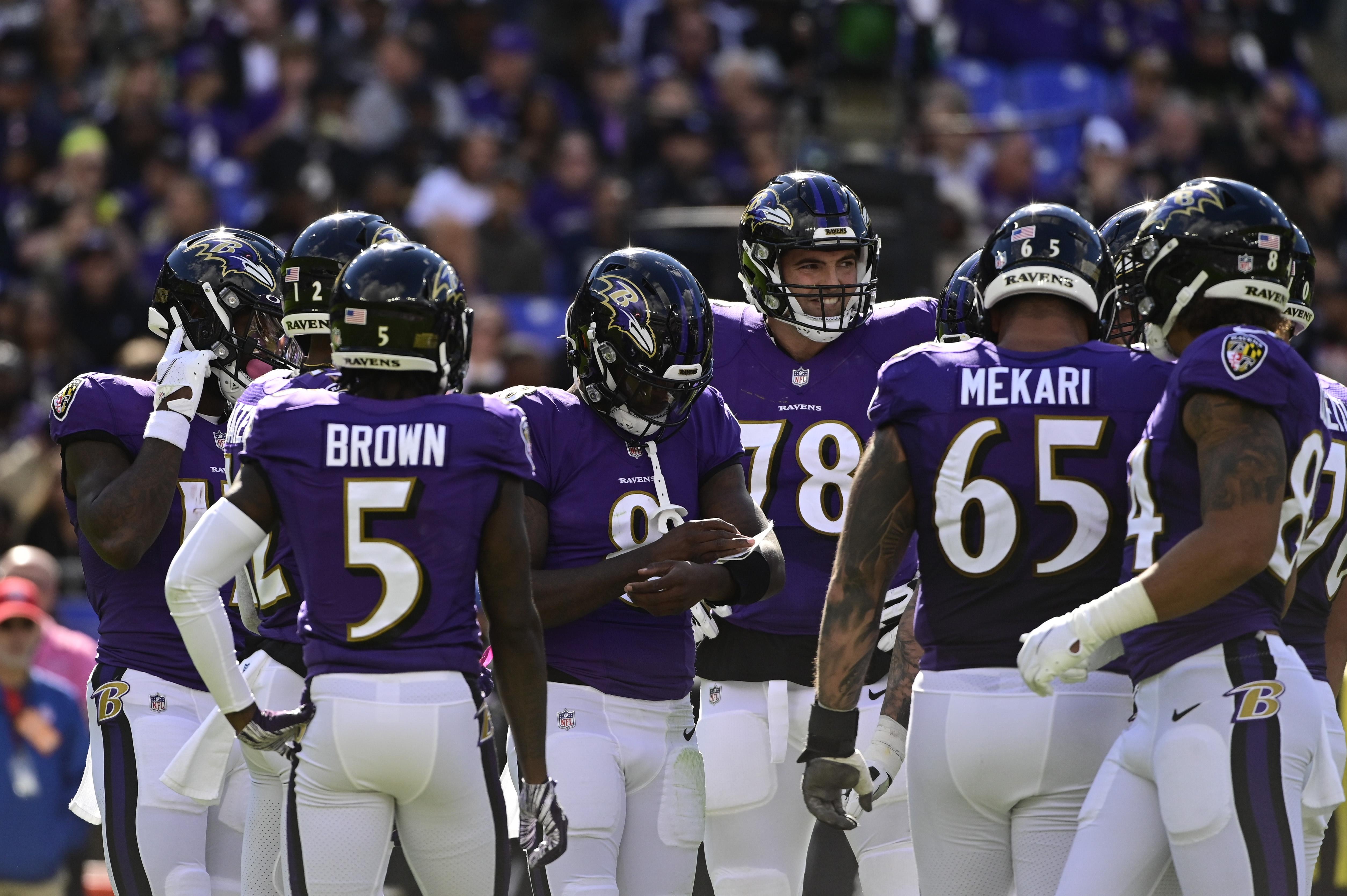 Baltimore Ravens quarterback Lamar Jackson (8) huddles with teammates during the second half Los Angeles Chargers at M&T Bank Stadium.