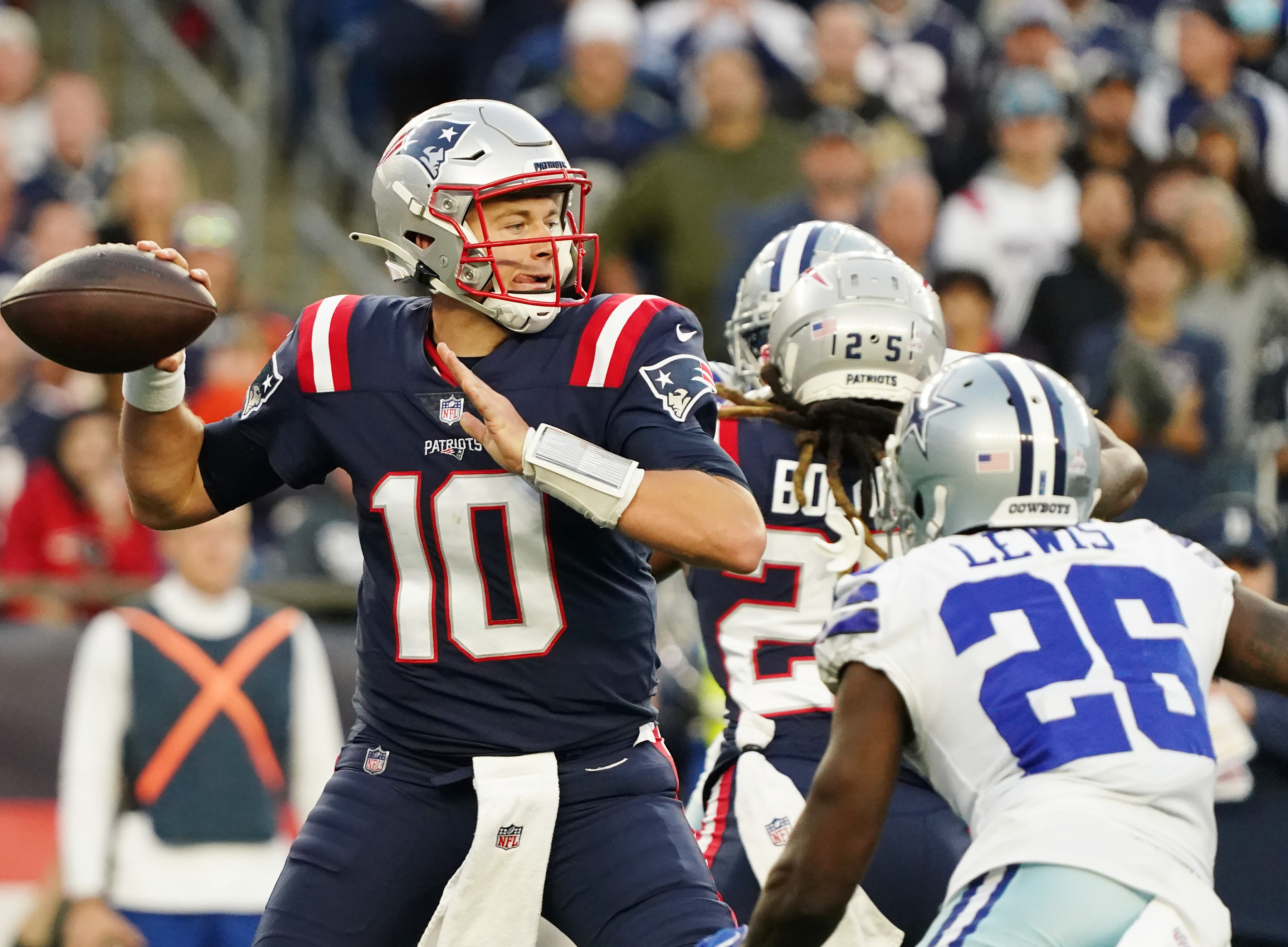 New England Patriots quarterback Mac Jones (10) throws a pass against the Dallas Cowboys in the first half at Gillette Stadium.