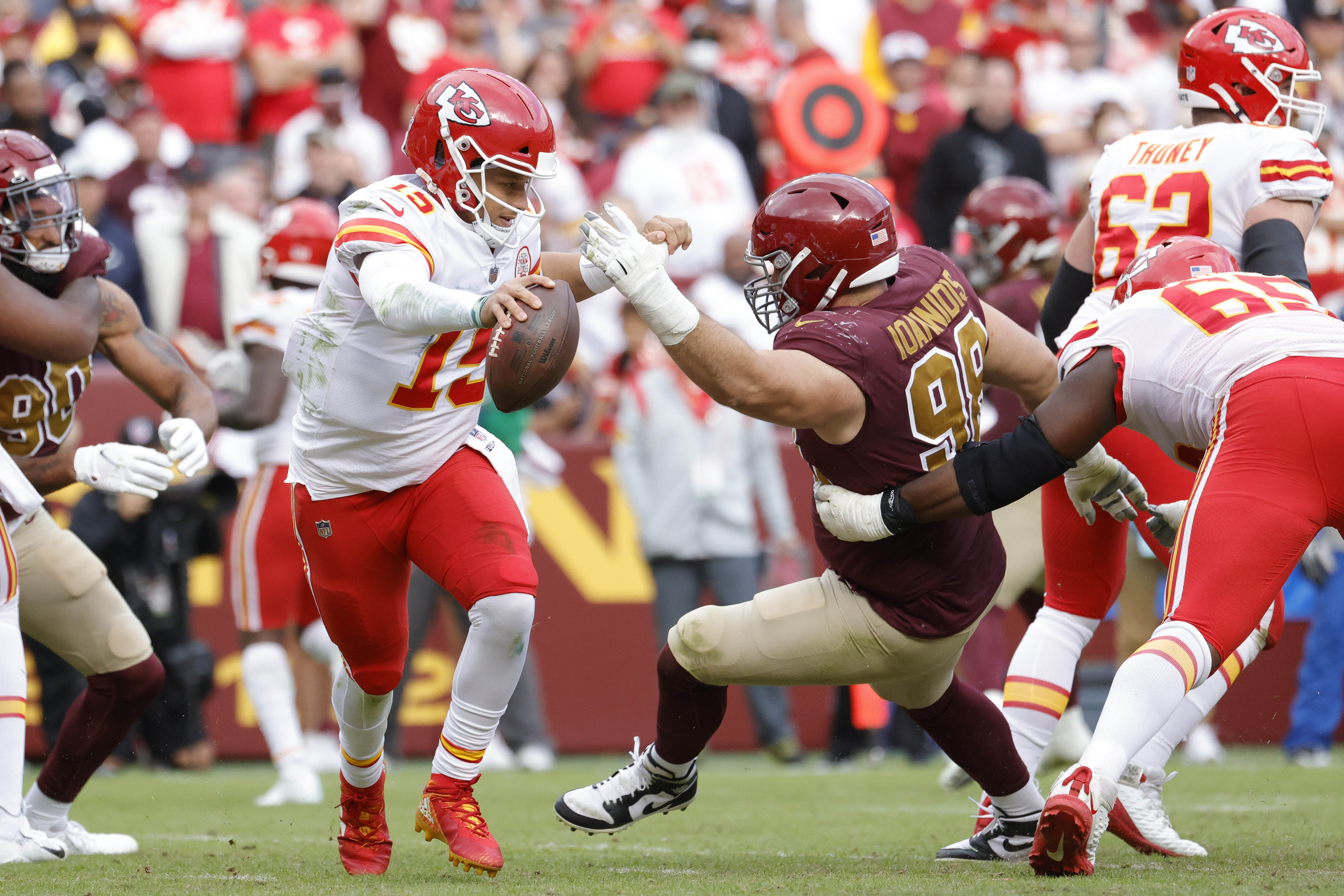City Chiefs quarterback Patrick Mahomes (15) scrambles from Washington Football Team defensive tackle Matt Ioannidis (98) during the fourth quarter at FedExField.