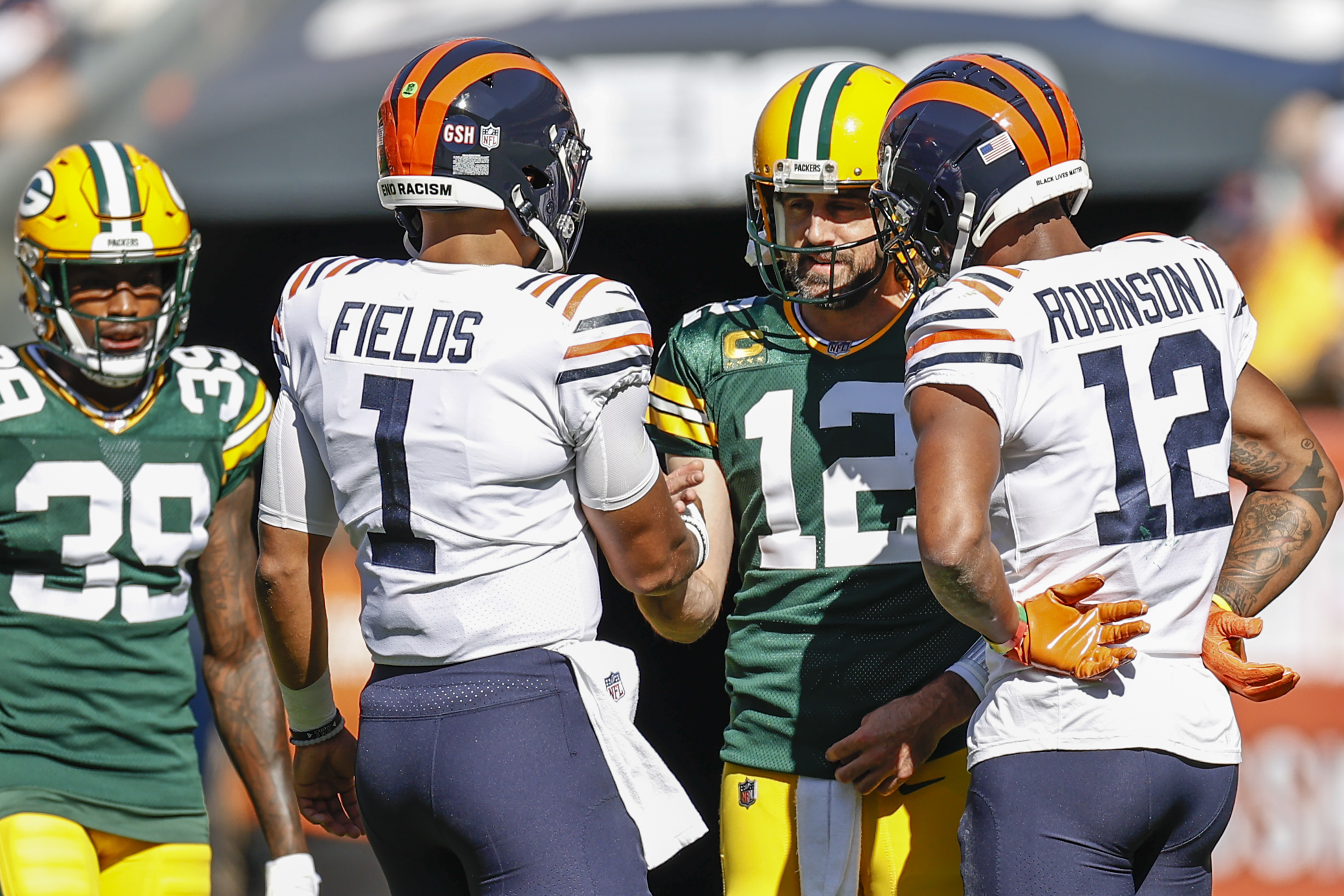 Bears quarterback Justin Fields shakes hands with Packers quarterback Aaron Rodgers.