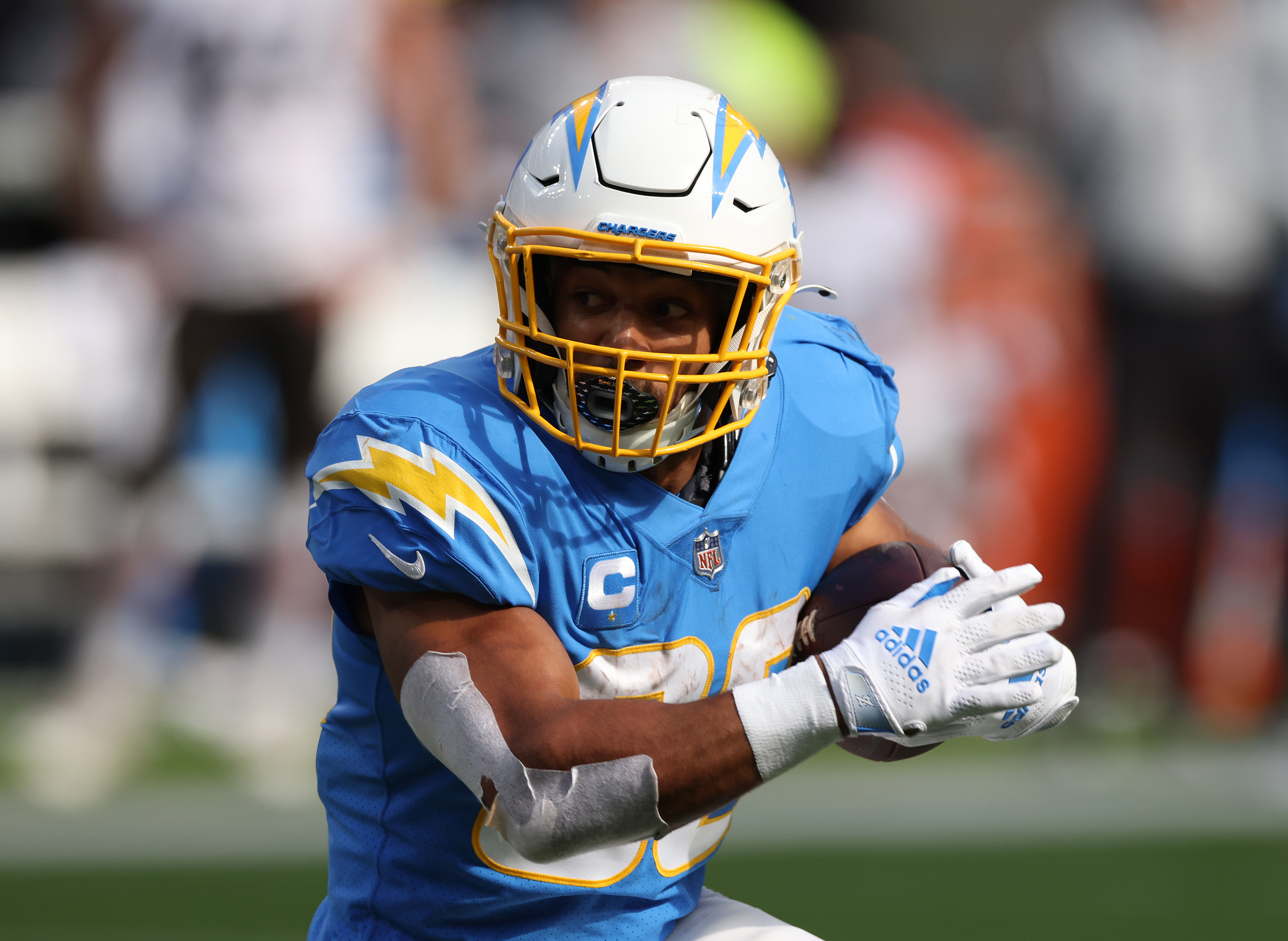 Austin Ekeler #30 of the Los Angeles Chargers carries the ball during a 47-42 win over the Cleveland Browns at SoFi Stadium on October 10, 2021 in Inglewood, California.