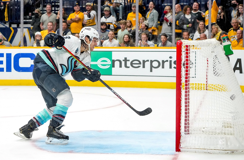 Brandon Tanev #13 of the Seattle Kraken scores an empty net goal against the Nashville Predators during an NHL game at Bridgestone Arena on October 14, 2021 in Nashville, Tennessee.