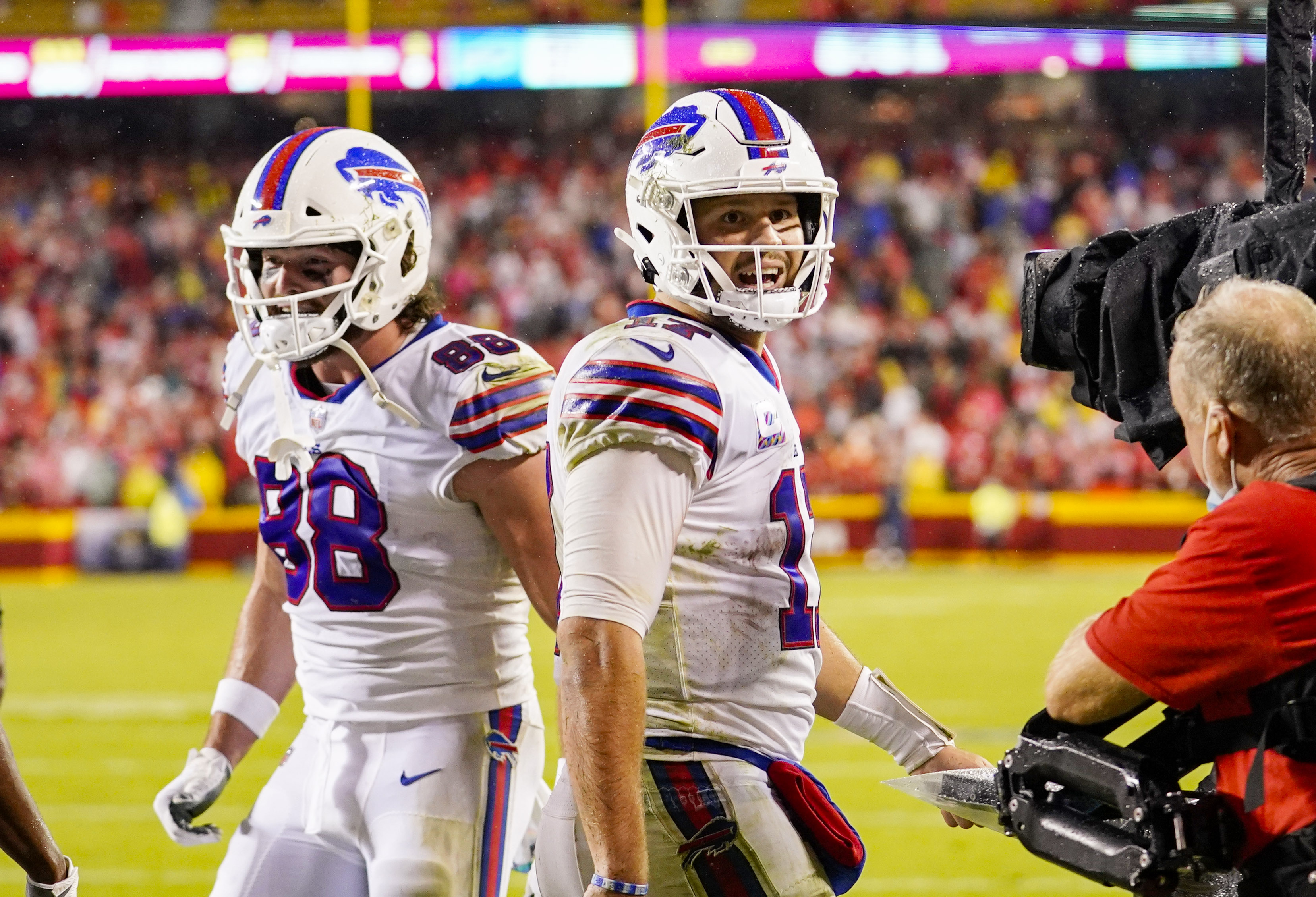 Buffalo Bills quarterback Josh Allen (17) and tight end Dawson Knox (88) celebrate after a touchdown against the Kansas City Chiefs during the second half at GEHA Field at Arrowhead Stadium.