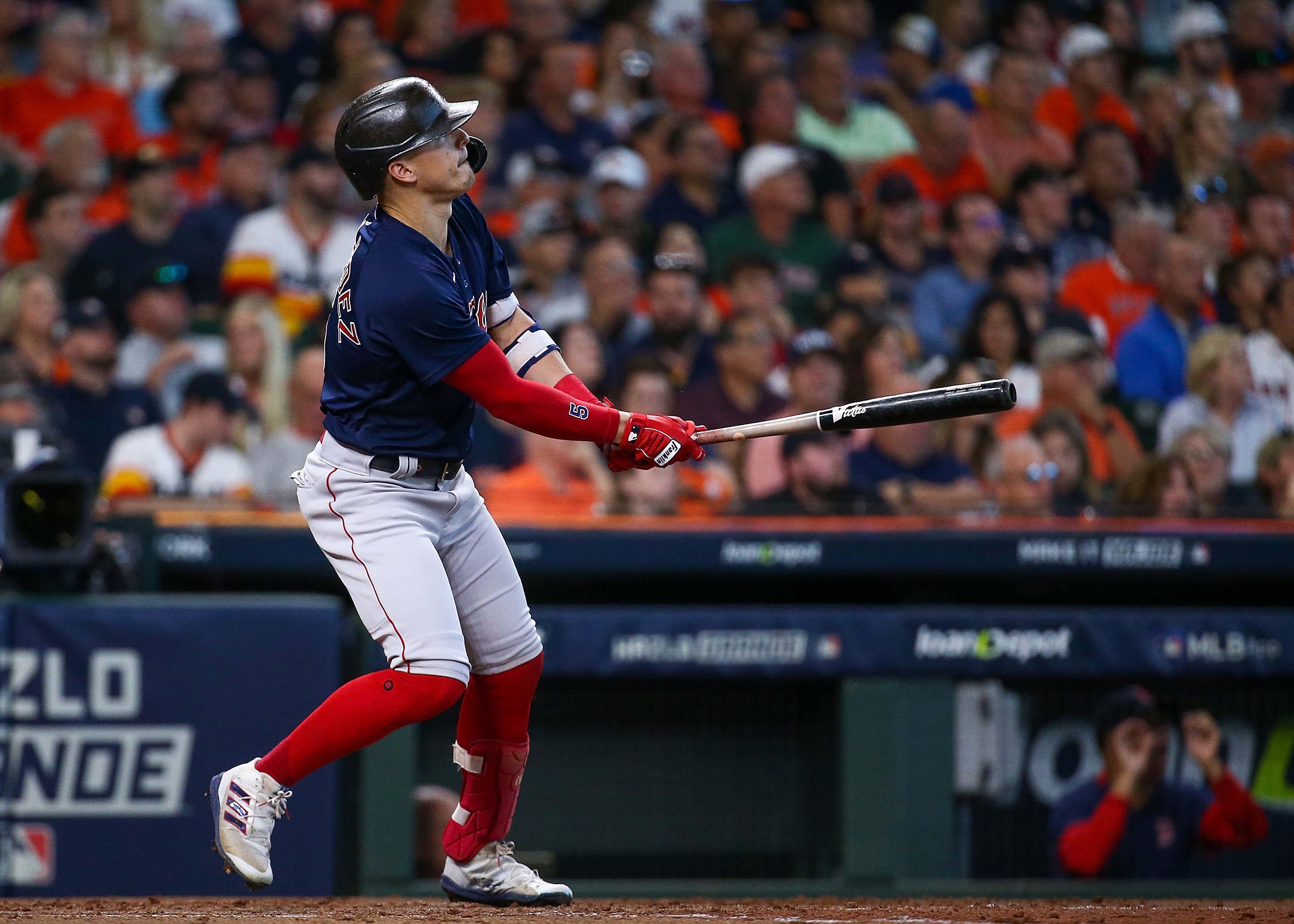 Boston Red Sox center fielder Enrique Hernandez (5) hits a solo home run against the Houston Astros during the fourth inning in game two of the 2021 ALCS at Minute Maid Park.