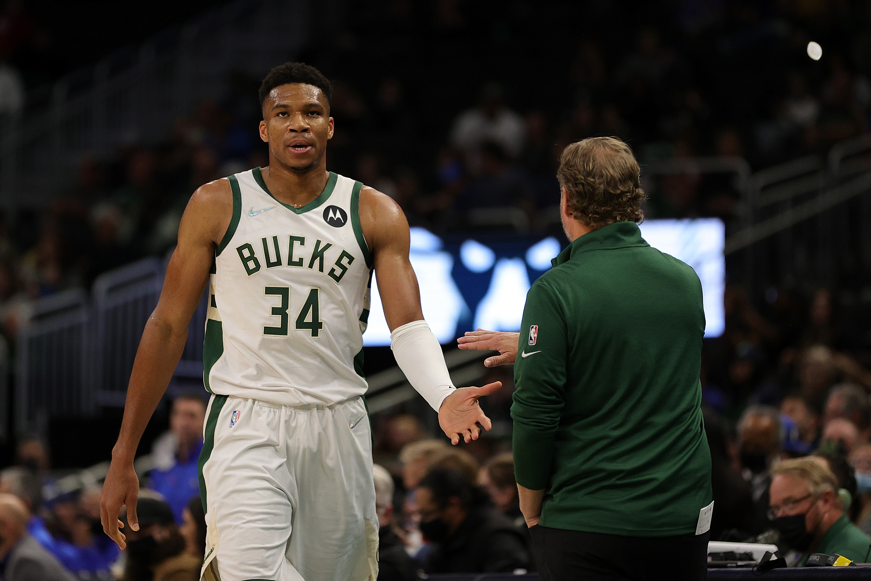 Giannis Antetokounmpo #34 of the Milwaukee Bucks walks to the bench during the first half of a game against the Dallas Mavericks at Fiserv Forum on October 15, 2021 in Milwaukee, Wisconsin.