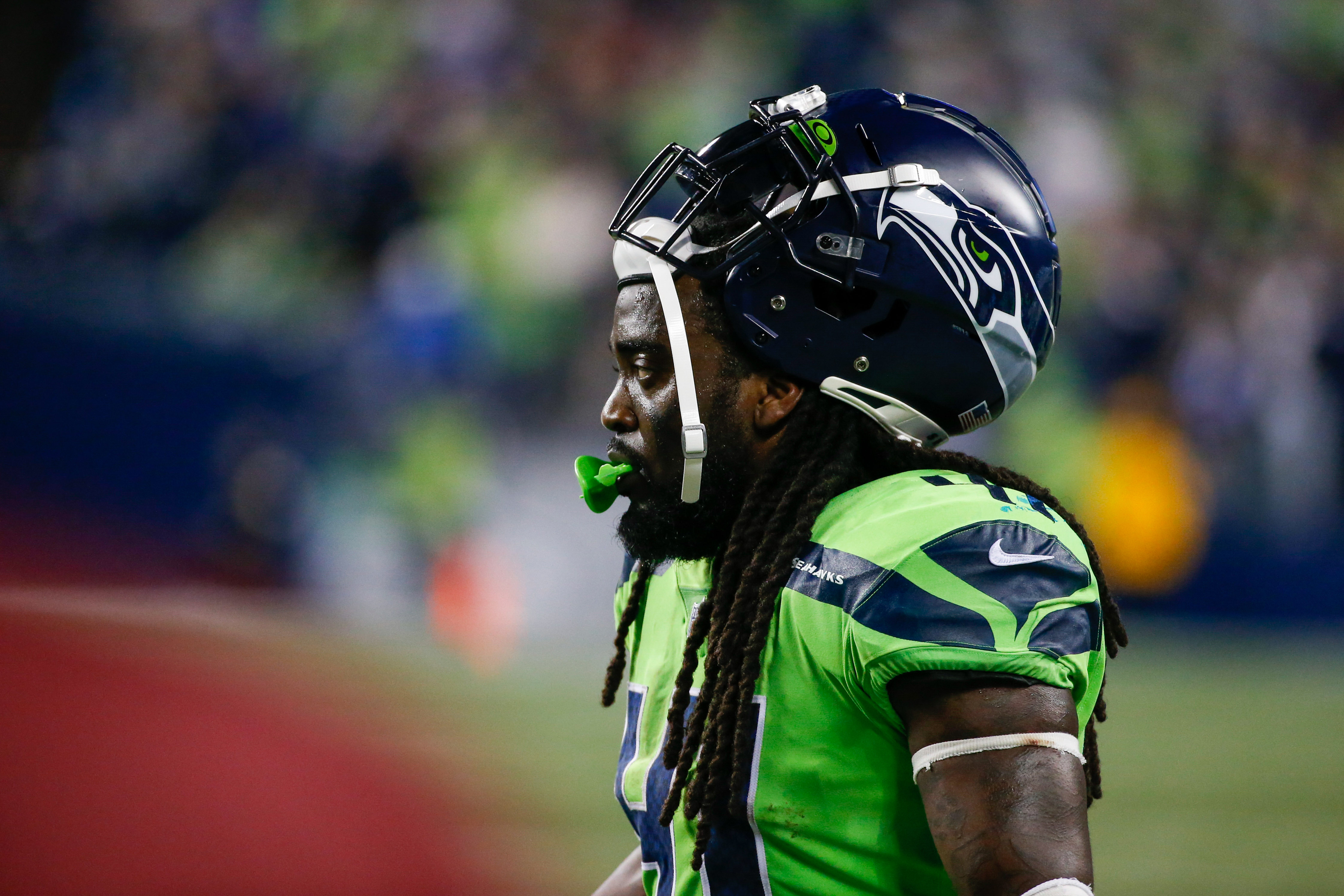Seattle Seahawks running back Alex Collins (41) stands on the sideline during the fourth quarter against the Los Angeles Rams at Lumen Field.