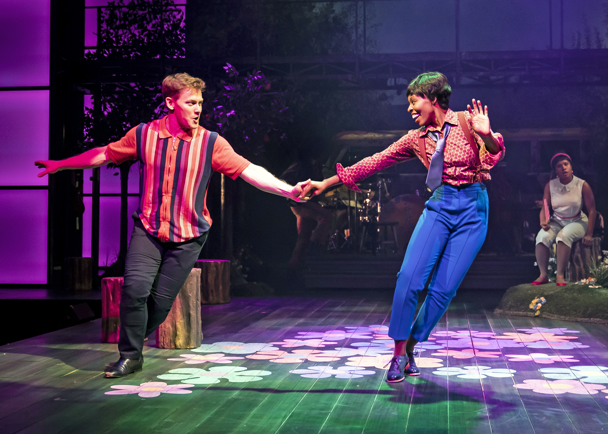 """Orlando (Liam Quealy, left) serenades his disguised love interest Rosalind (Lakeisha Renee) in Chicago Shakespeare Theater's Beatles music-infused production of""""As You Like It."""""""