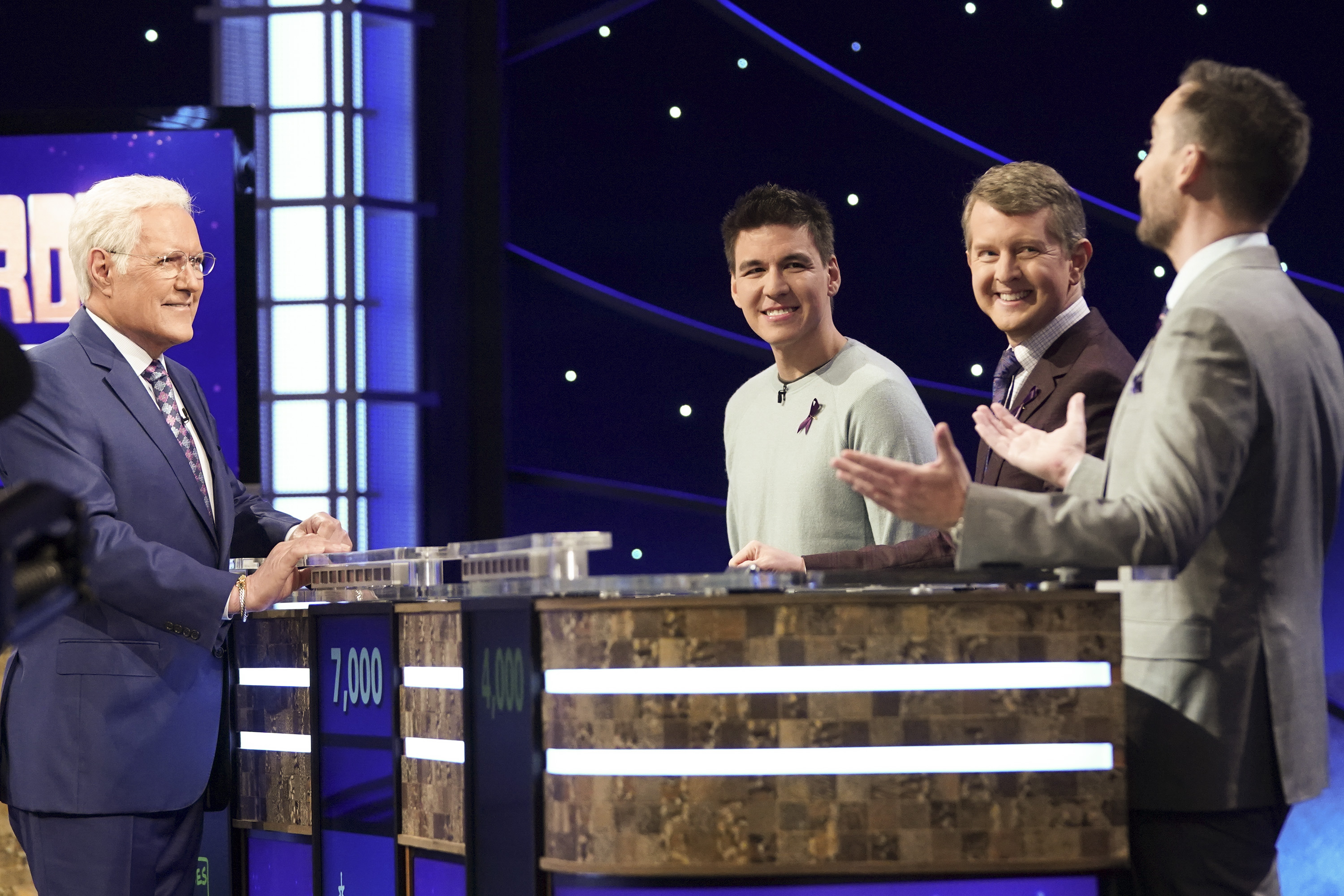 """Late """"Jeopardy!"""" host Alex Trebek chats with """"Jeopardy! The Greatest of All Time"""" contestants James Holzhauer, Ken Jennings and Brad Rutter."""