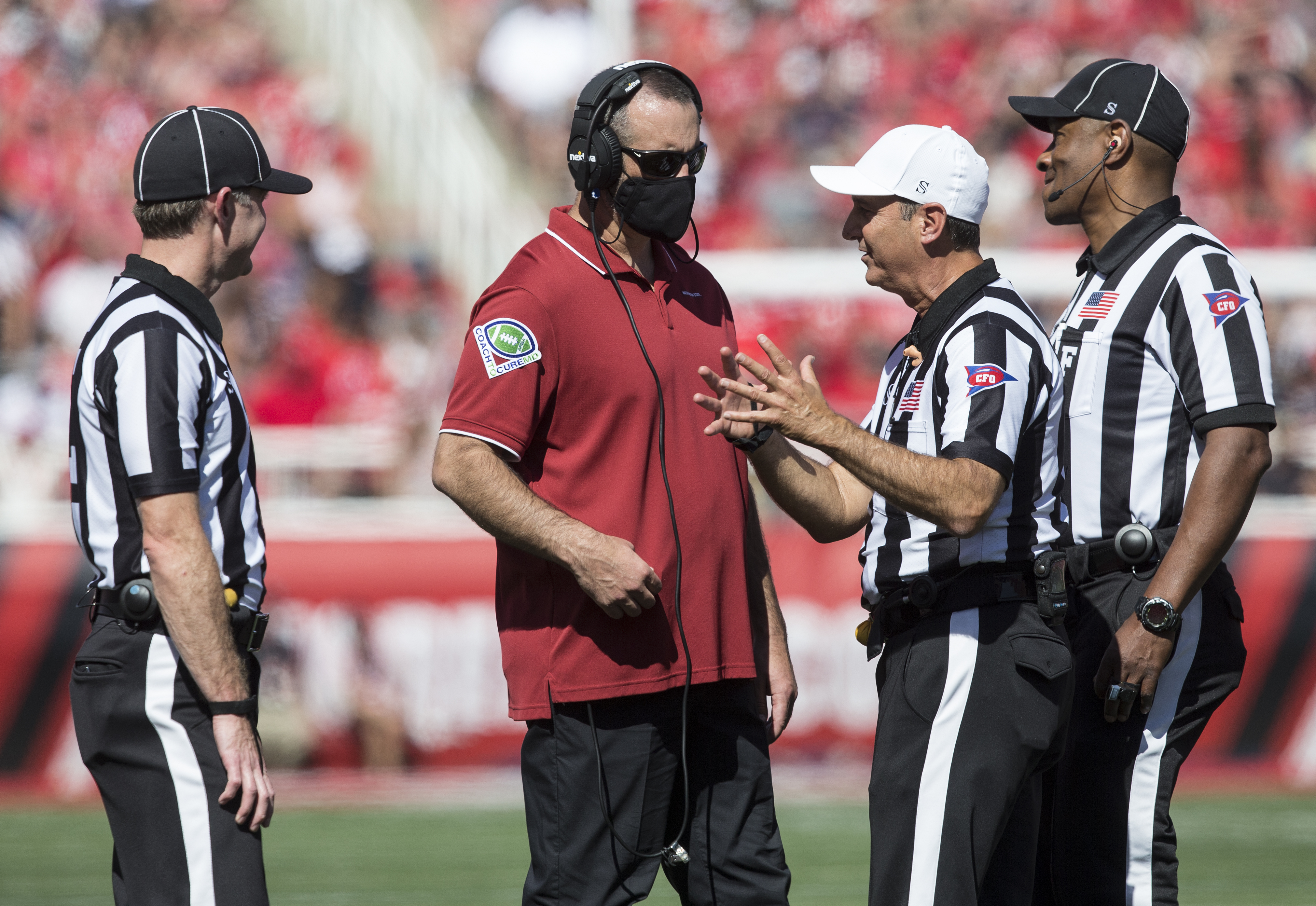 Nick Rolovich head coach of the Washington State Cougars talks with officials during their game against the Utah Utes September 25, 2021 at Rice Eccles Stadium in Salt Lake City, Utah.