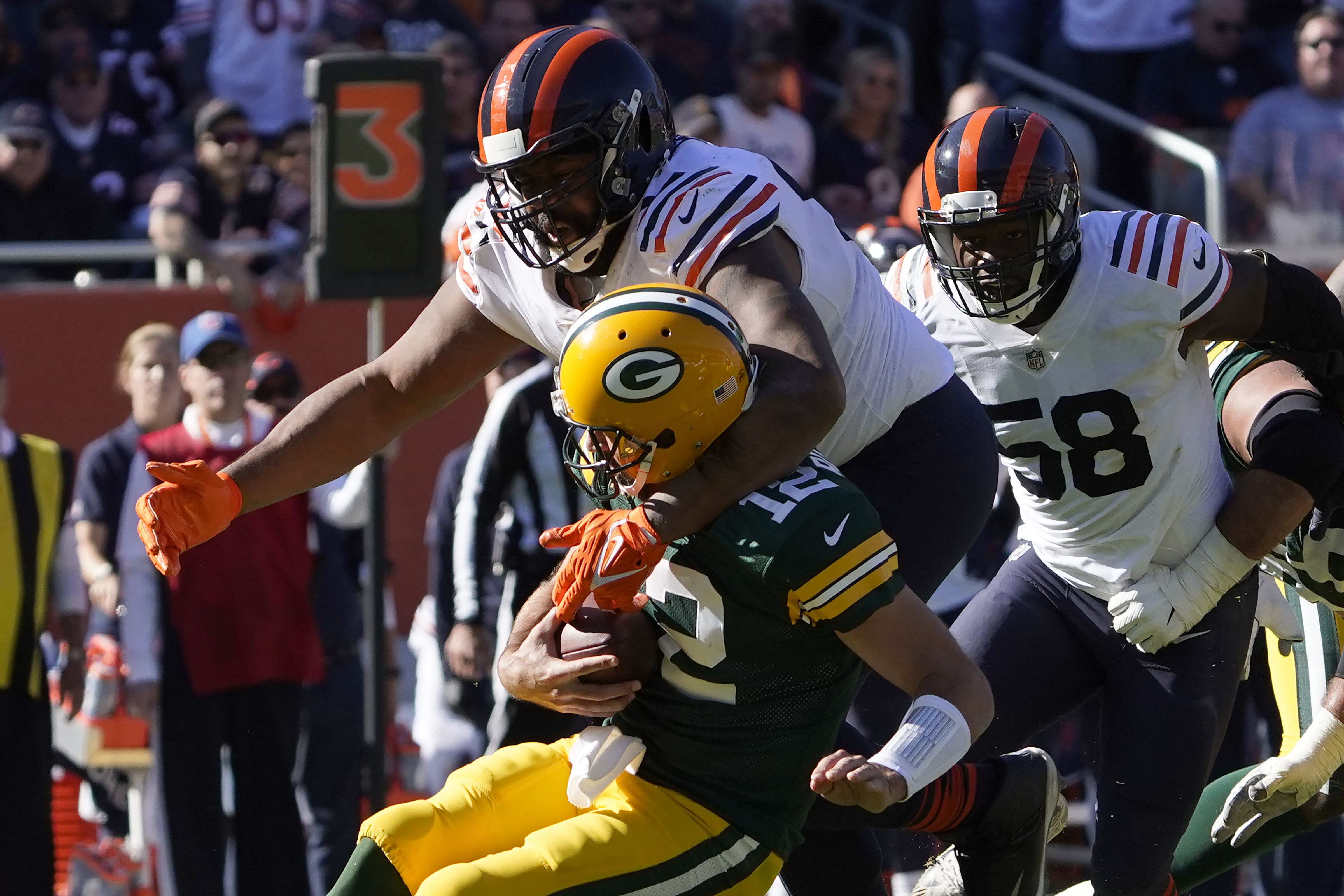 Bears defensive end Akiem Hicks (96) sacks Aaron Rodgers for a 10-yard loss in the third quarter Sunday at Soldier Field.