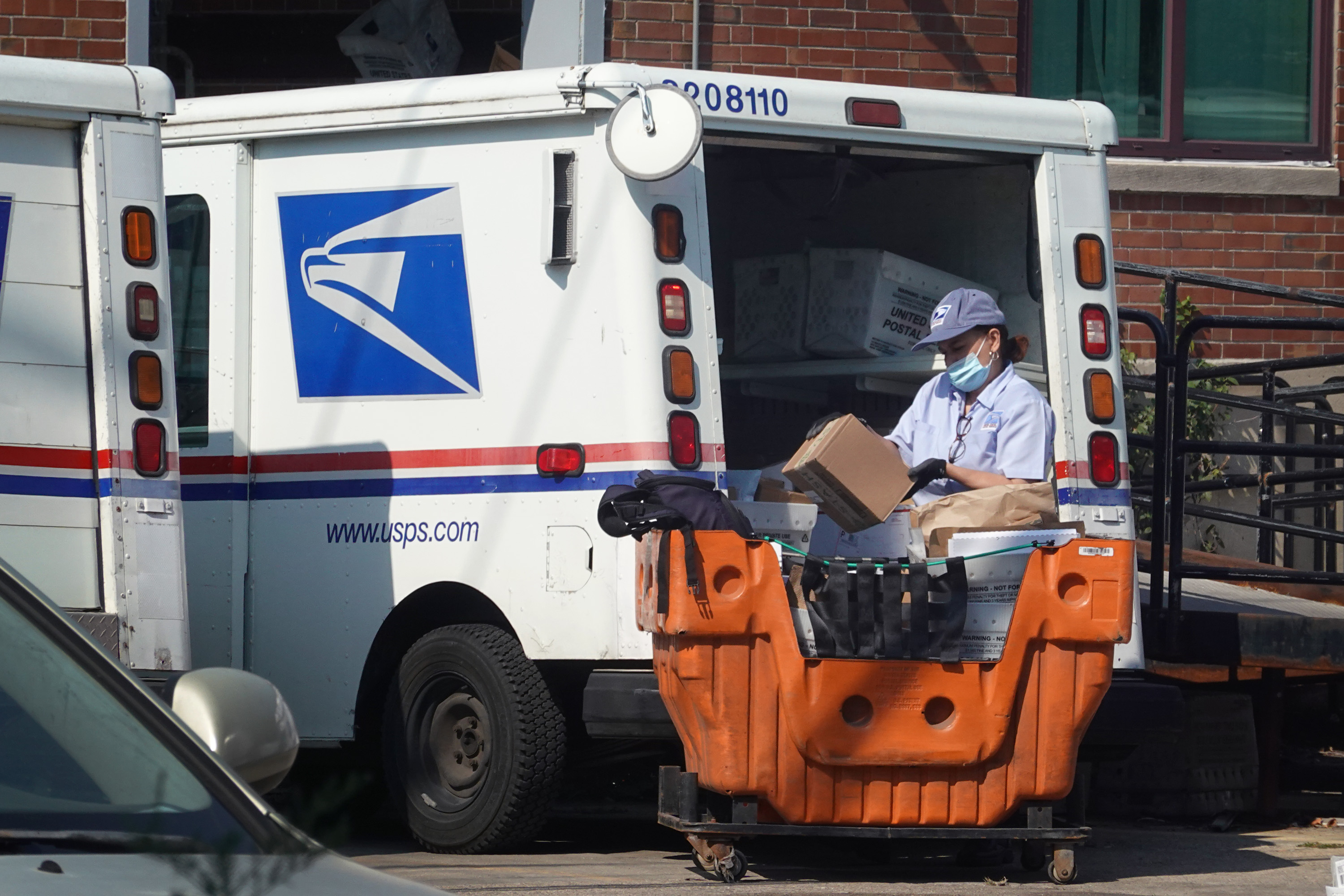 A postal worker loads a delivery truck on Oct. 1, 2021 in Chicago.