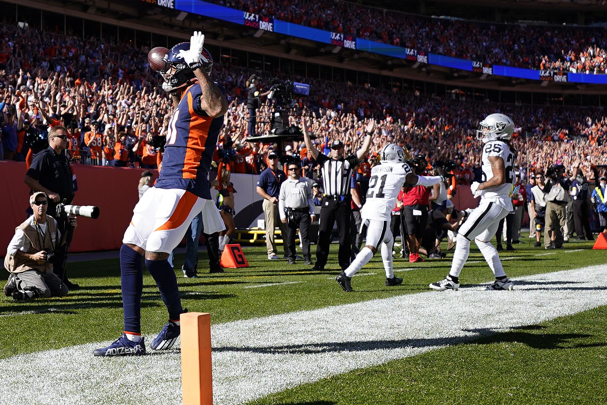 Denver Broncos wide receiver Tim Patrick scores a touchdown against the Las Vegas Raiders.