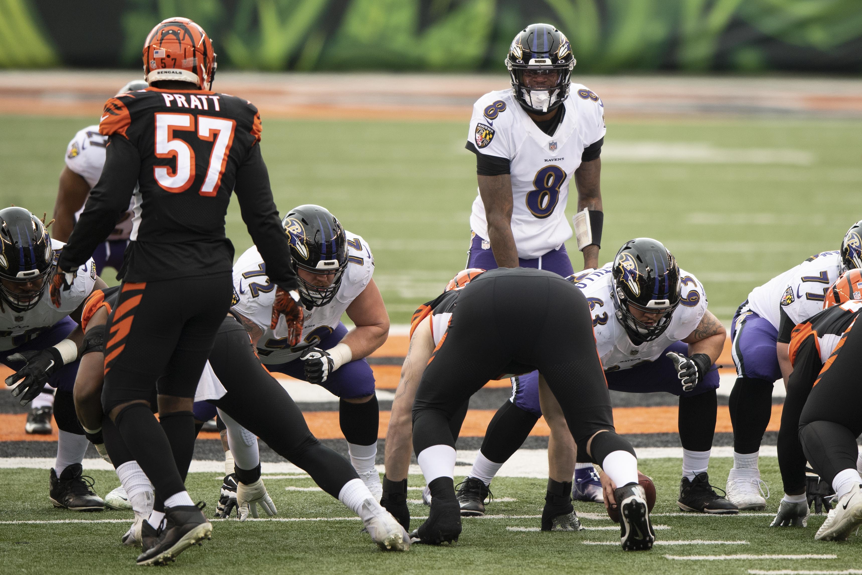 Baltimore Ravens quarterback Lamar Jackson (8) calls a play during an NFL football game against the Cincinnati Bengals.