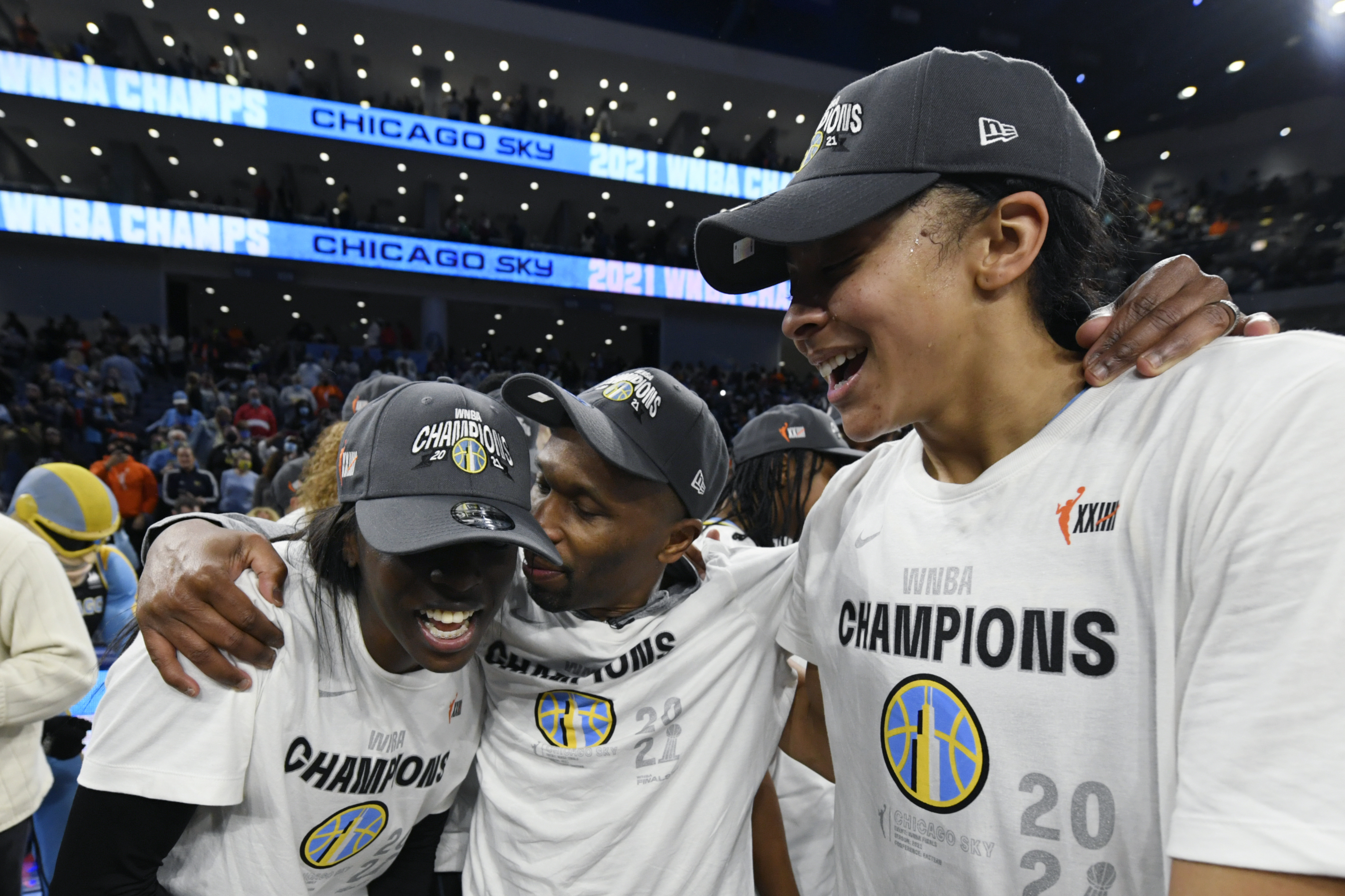 Sky GM/head coach James Wade, center, celebrates with Candice Parker, right, and Kahleah Copper after winning the WNBA championship at Wintrust Arena.