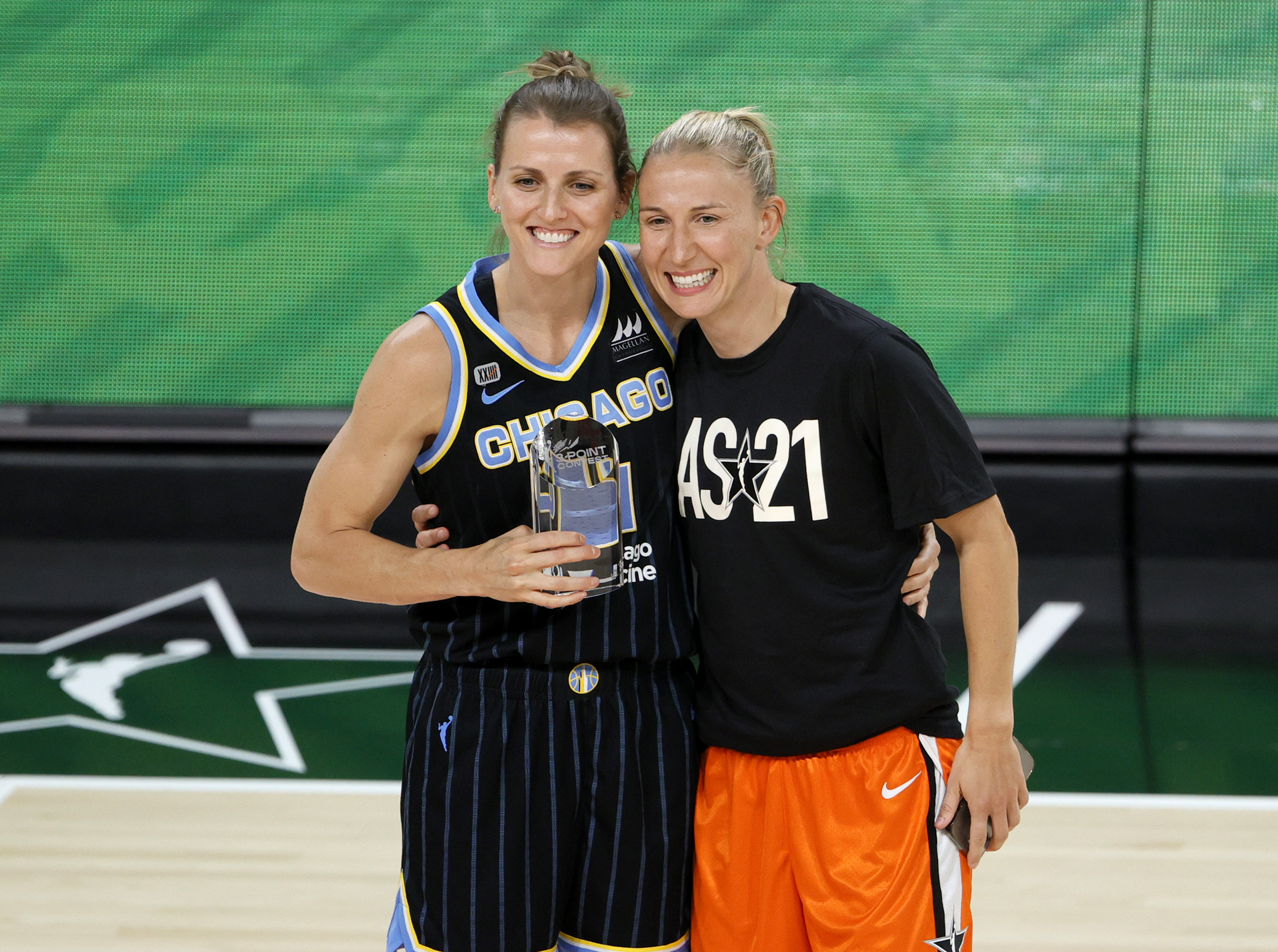 Allie Quigley (left) and wife Courtney Vandersloot pose after Quigley won the three-point contest at the 2021 WNBA All-Star Game in Las Vegas.