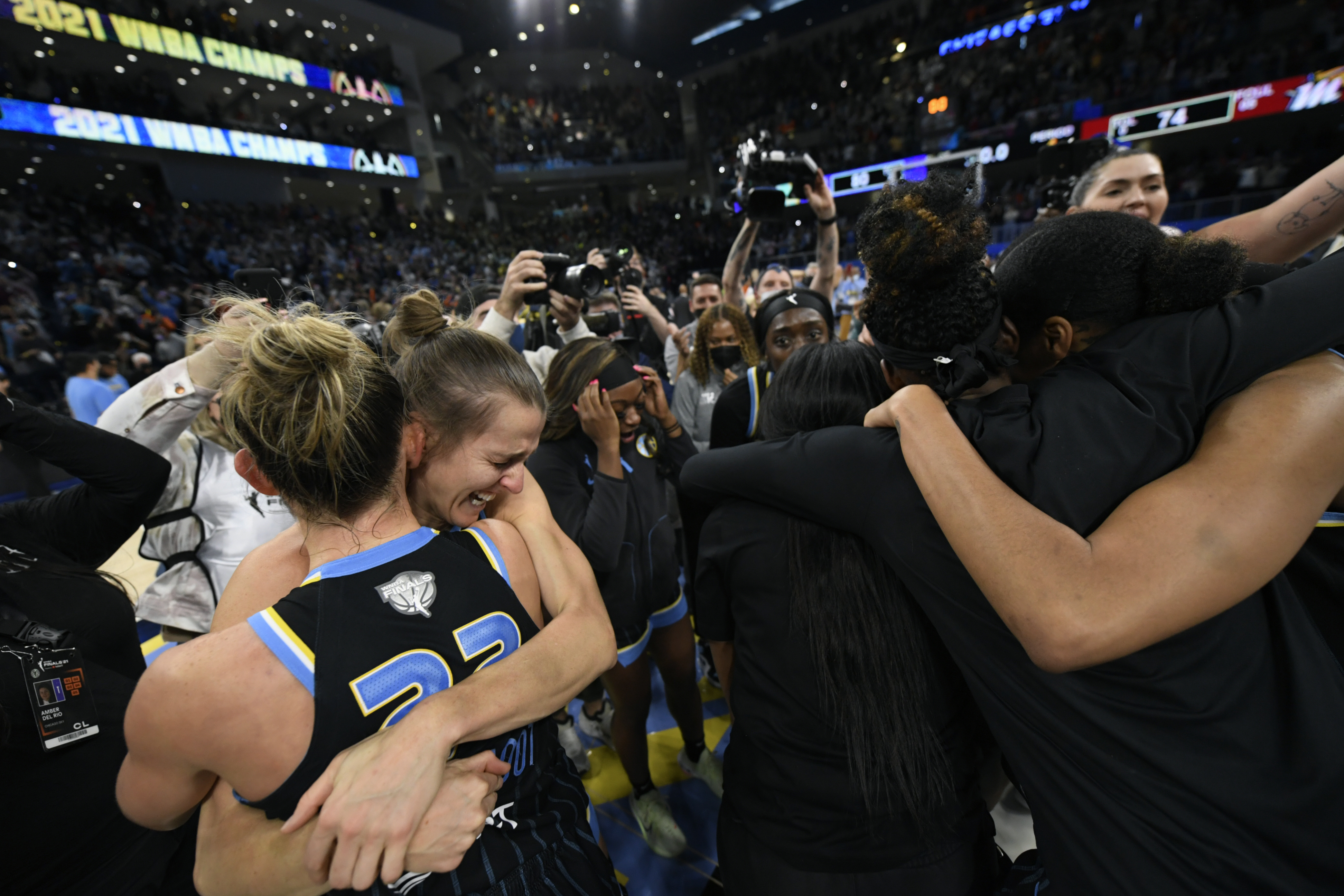 Sky guards Courtney Vandersloot and Allie Quigley celebrate after winning the WNBA title Sunday at Wintrust Arena.