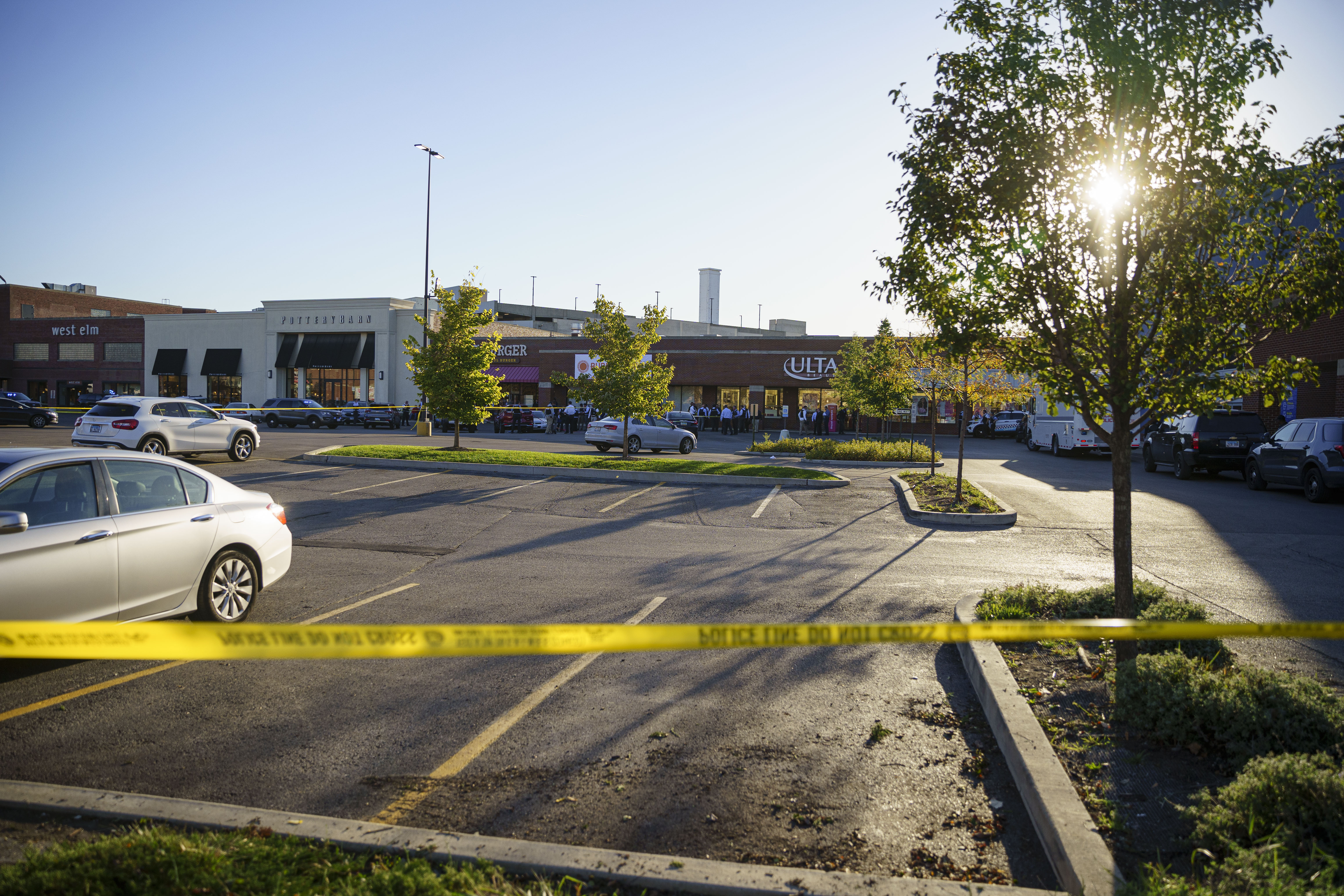Police investigate the scene where a police officer was shot, Monday, Oct. 18, 2021, in the parking lot of a shopping center at 1000 W. North Ave. in Lincoln Park.