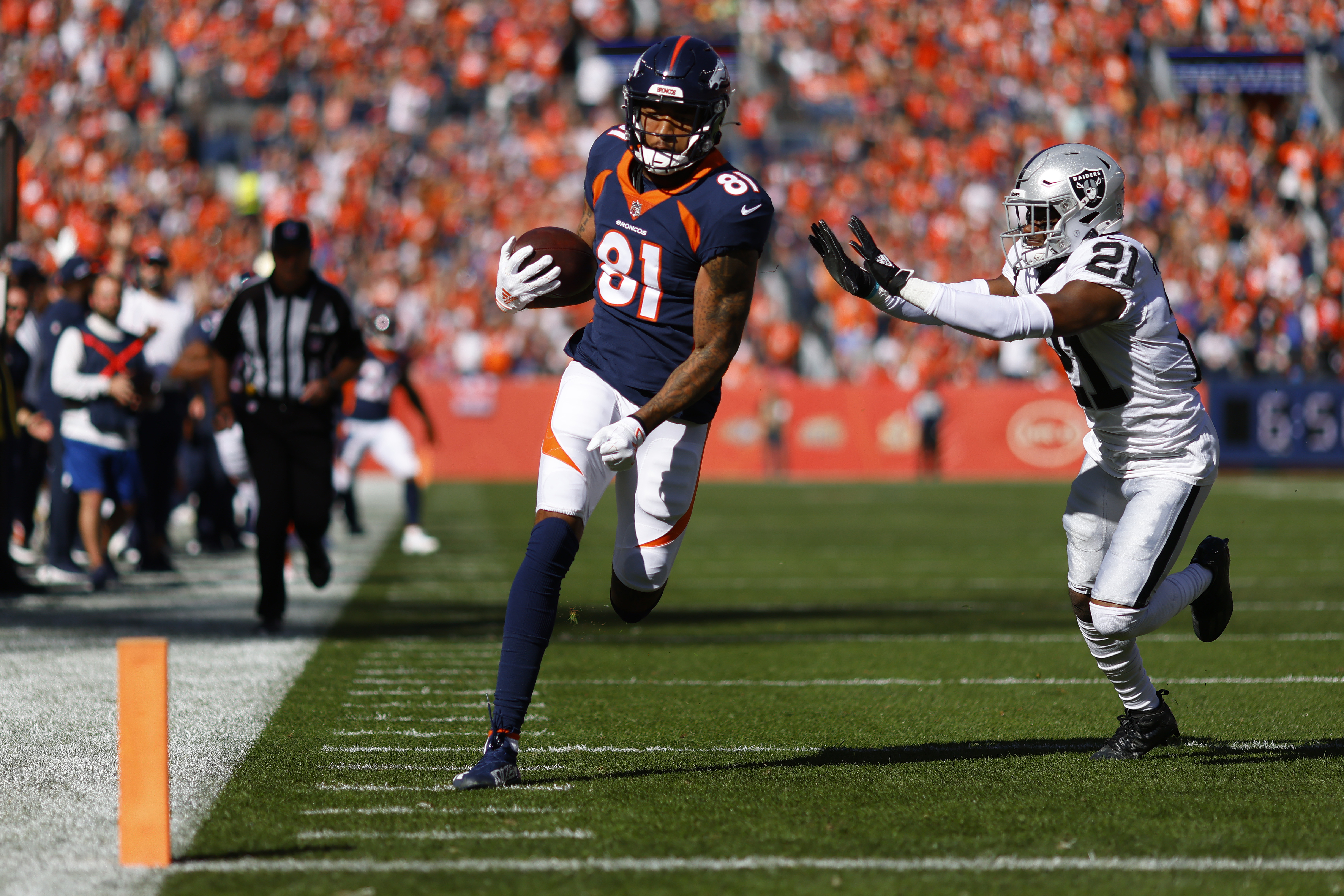Tim Patrick #81 of the Denver Broncos scores a touchdown against Amik Robertson #21 of the Las Vegas Raiders during the first quarter at Empower Field At Mile High on October 17, 2021 in Denver, Colorado.