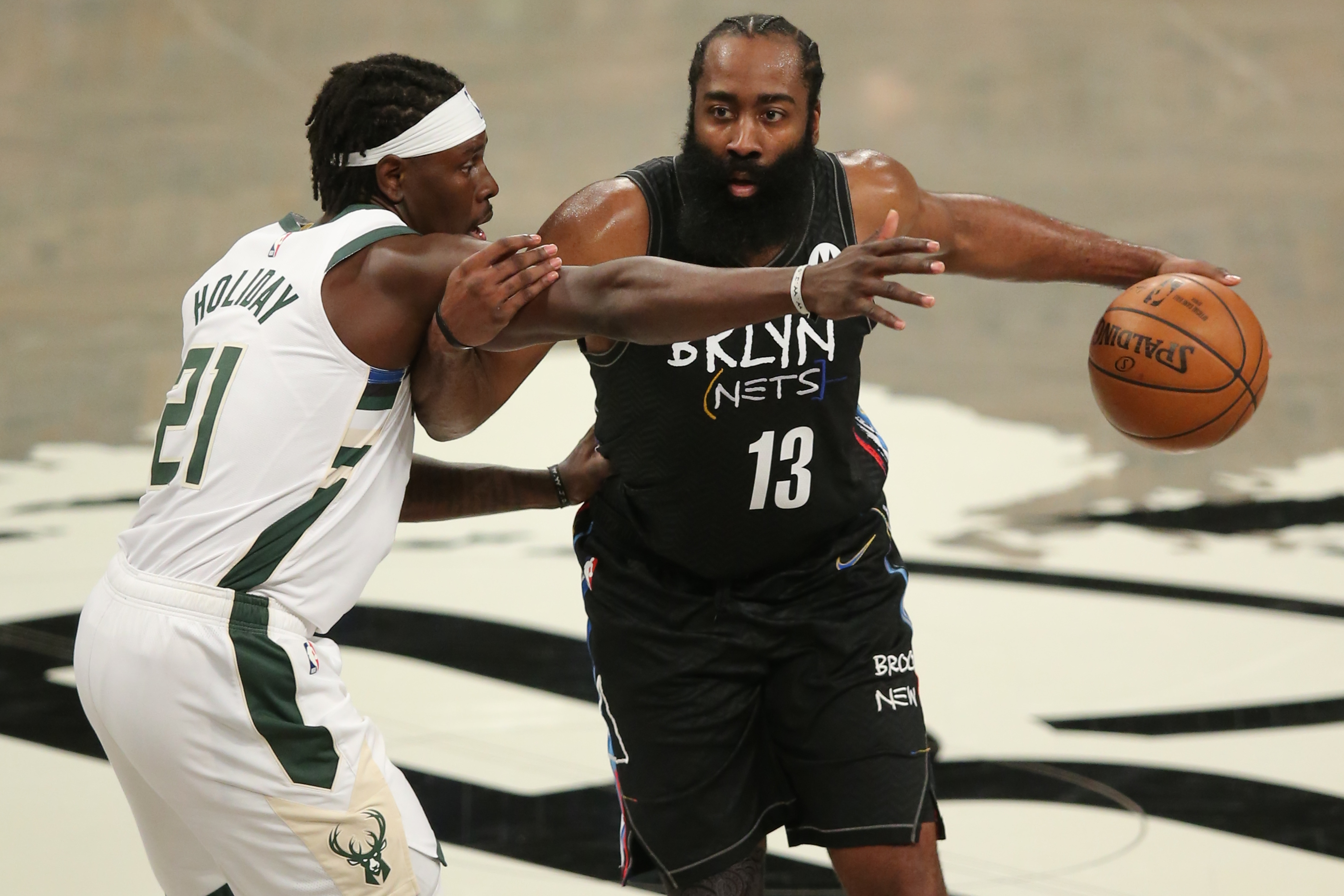 Brooklyn Nets shooting guard James Harden (13) controls the ball against Milwaukee Bucks point guard Jrue Holiday (21) during the third quarter of game five of the second round of the 2021 NBA Playoffs at Barclays Center.