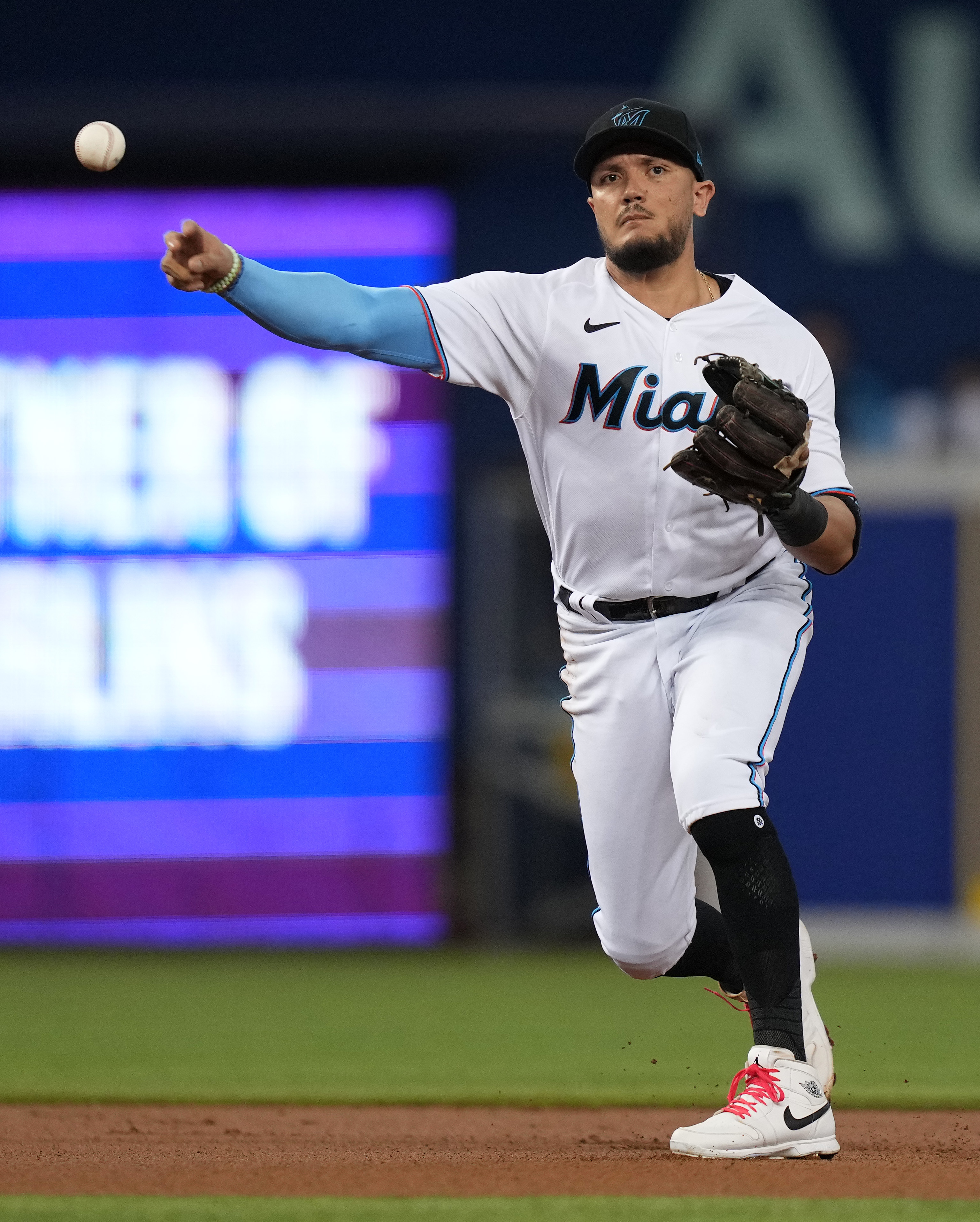 Miami Marlins shortstop Miguel Rojas (19) throws out New York Mets second baseman Javier Baez (not pictured) in the 1st inning at loanDepot park